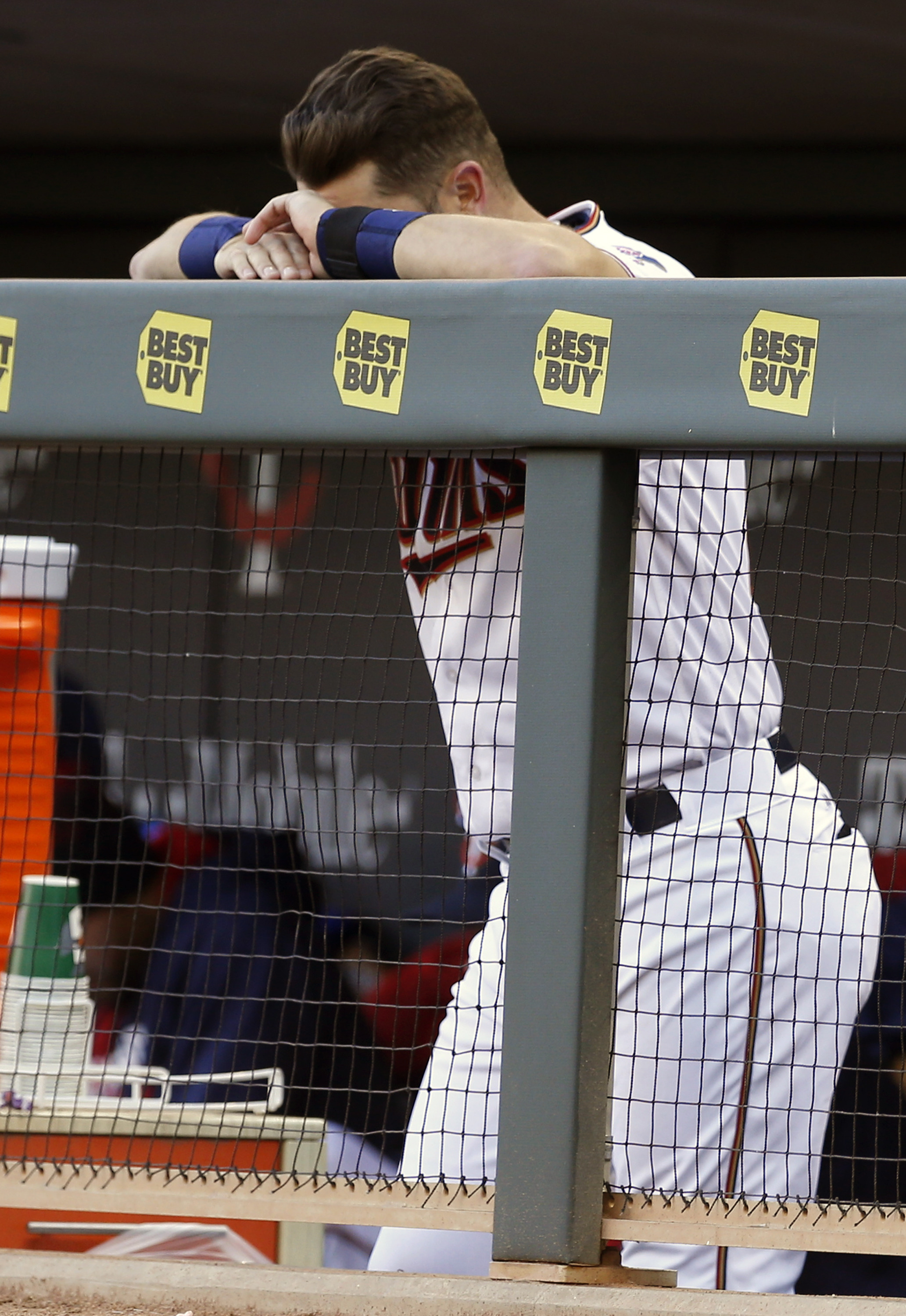 Minnesota Twins Trevor Plouffe rests his head on his hands in the final minutes of a baseball game against the Chicago White Sox Monday, April 11, 2016, in Minneapolis. The White Sox won 4-1, handing the Twins their seventh loss against no wins for the yo