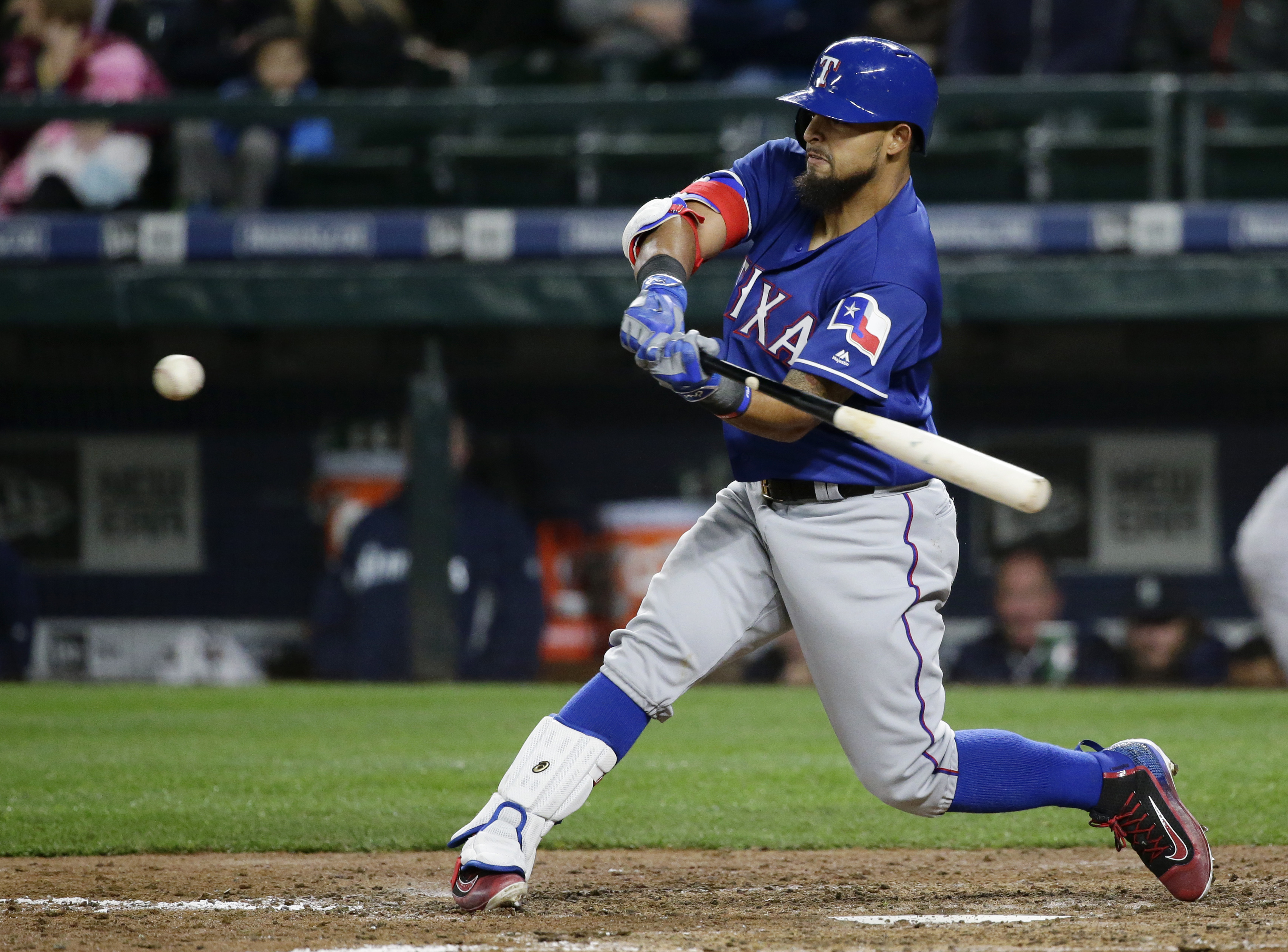 Texas Rangers' Rougned Odor hits a two-run single in the eighth inning of a baseball game against the Seattle Mariners, Monday, April 11, 2016, in Seattle. (AP Photo/Ted S. Warren)