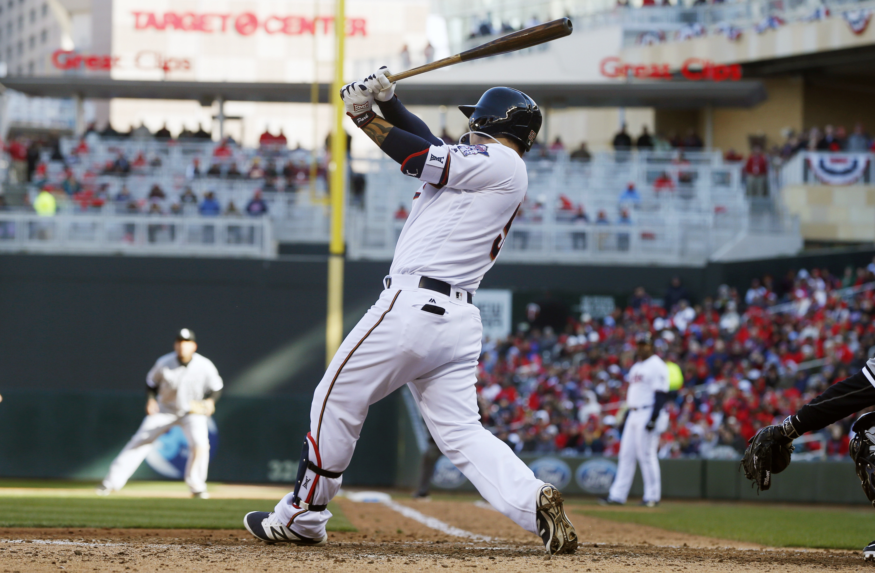In this April 11, 2016 photo, Minnesota Twins' Byung Ho Park of South Korea swings the bat in a baseball game against the Chicago White Sox in Minneapolis. The Twins are the only winless team left in the American League, off to the franchise's worst start