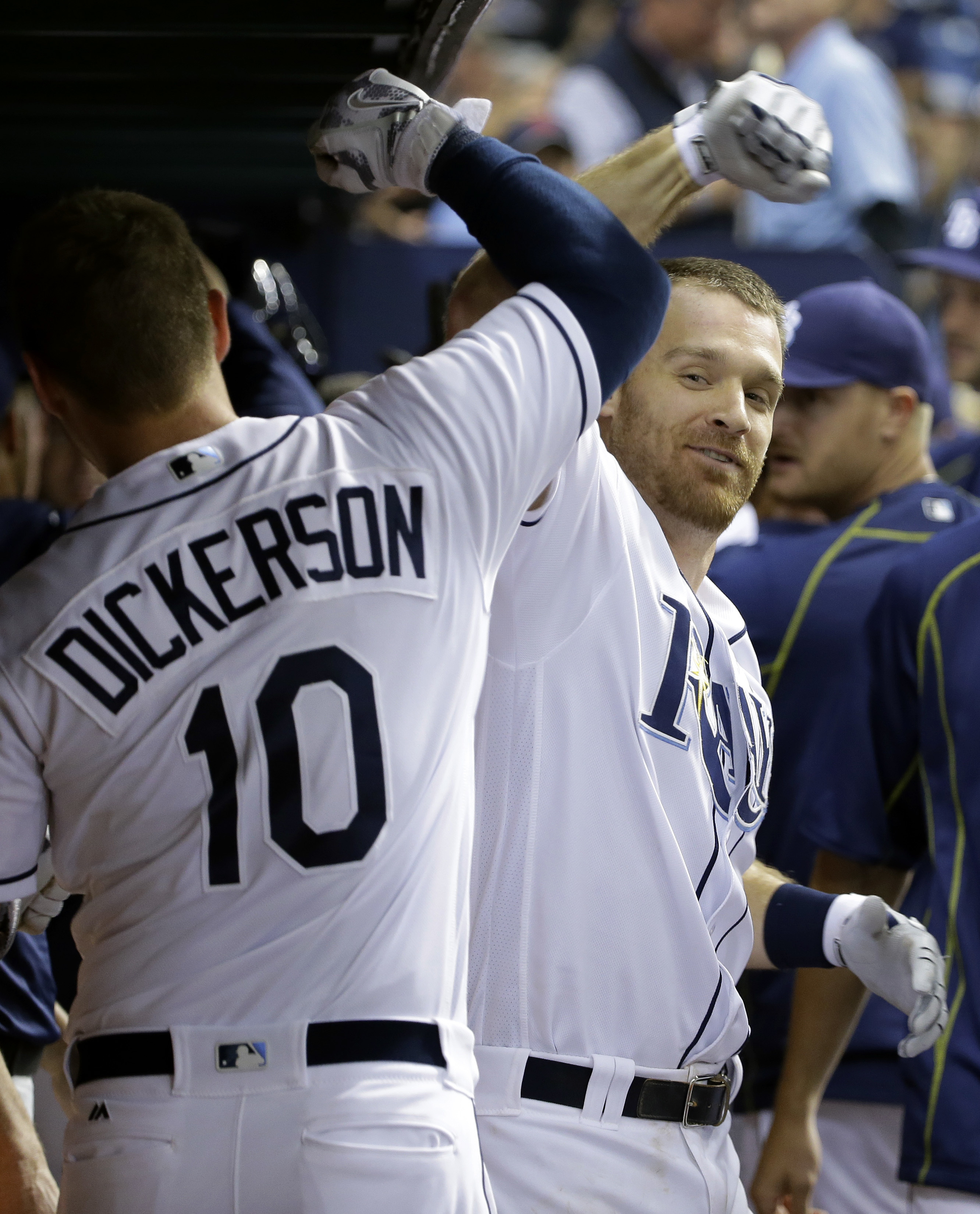 Tampa Bay Rays' Logan Forsythe, right, celebrates with teammate Corey Dickerson after hitting a two-run home run off Cleveland Indians starting pitcher Corey Kluber during the eighth inning of a baseball game Tuesday, April 12, 2016, in St. Petersburg, Fl