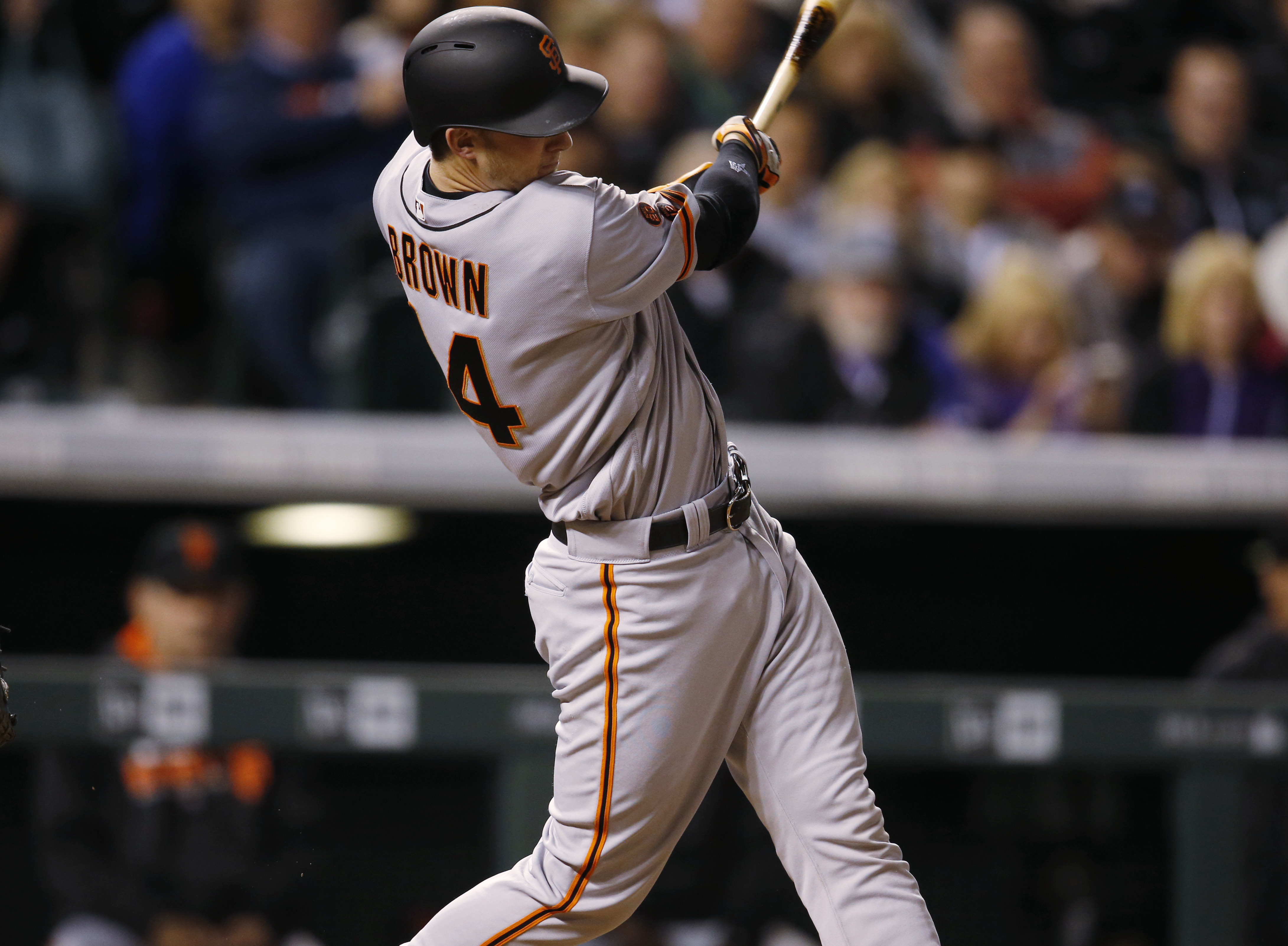 San Francisco Giants' Trevor Brown follows through on a two-run home run off Colorado Rockies starting pitcher Tyler Chatwood during the sixth inning of a baseball game Tuesday, April 12, 2016, in Denver. The Giants won 7-2. (AP Photo/David Zalubowski)