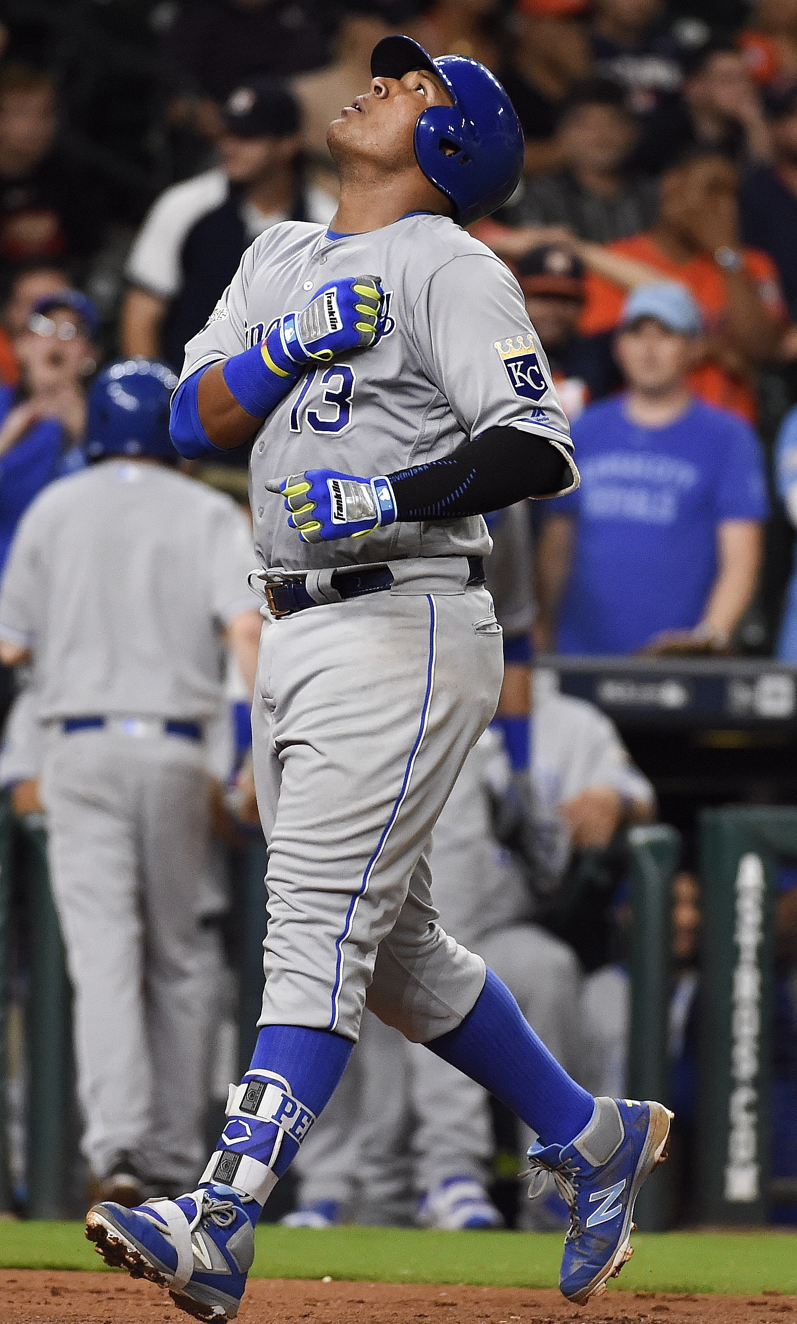 Kansas City Royals' Salvador Perez (13) celebrates his two-run home run in the eighth inning of a baseball game against the Houston Astros, Wednesday, April 13, 2016, in Houston. (AP Photo/Eric Christian Smith)