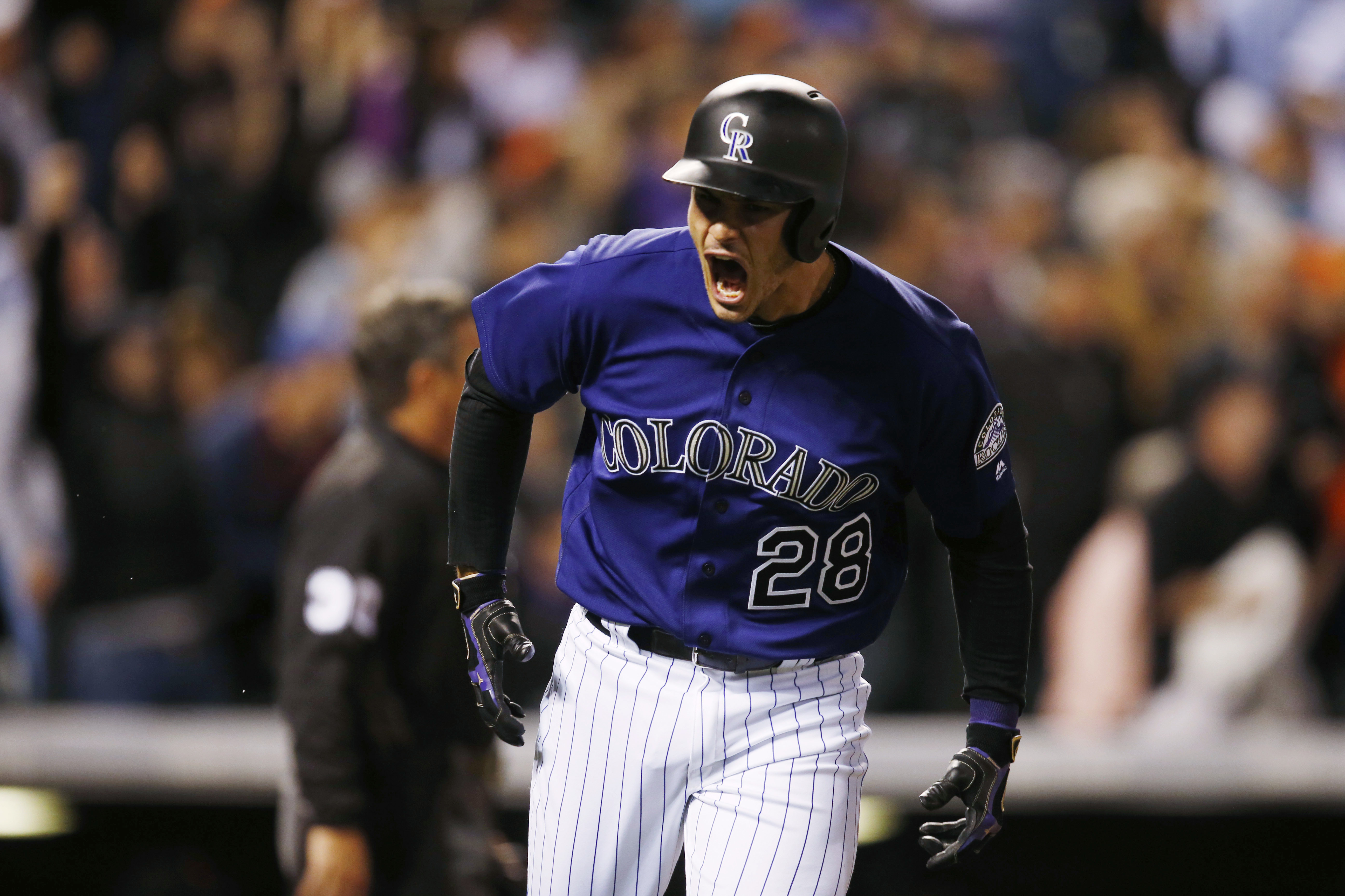 Colorado Rockies' Nolan Arenado yells as he runs up the first base line after hitting a three-run home run off San Francisco Giants relief pitcher Josh Osich in the eighth inning of a baseball game Wednesday, April 13, 2016, in Denver. Colorado won 10-6.