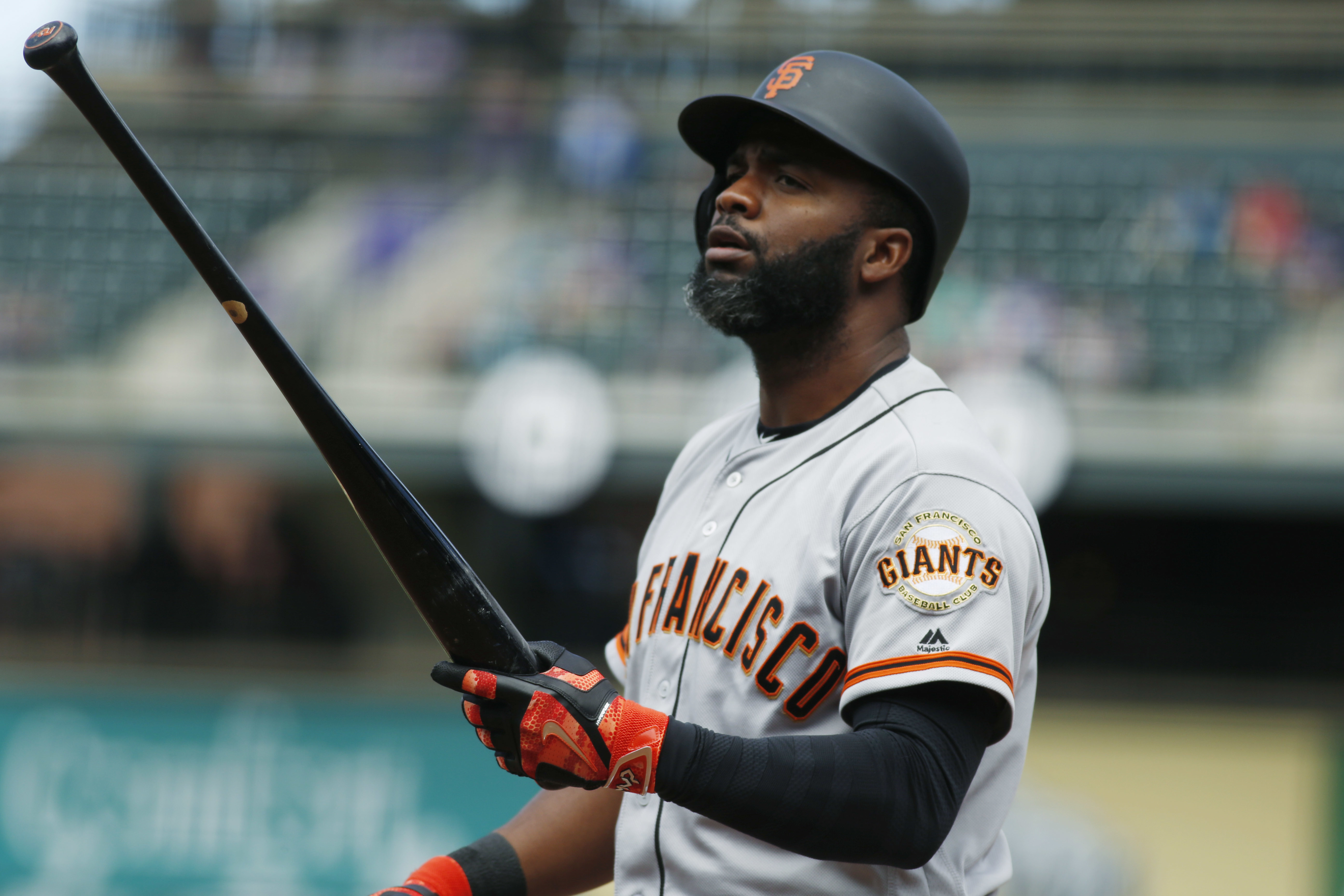 San Francisco Giants' Denard Span reacts after striking out against Colorado Rockies starting pitcher Jorge De La Rosa in the first inning of a baseball game Thursday, April 14, 2016, in Denver. (AP Photo/David Zalubowski)