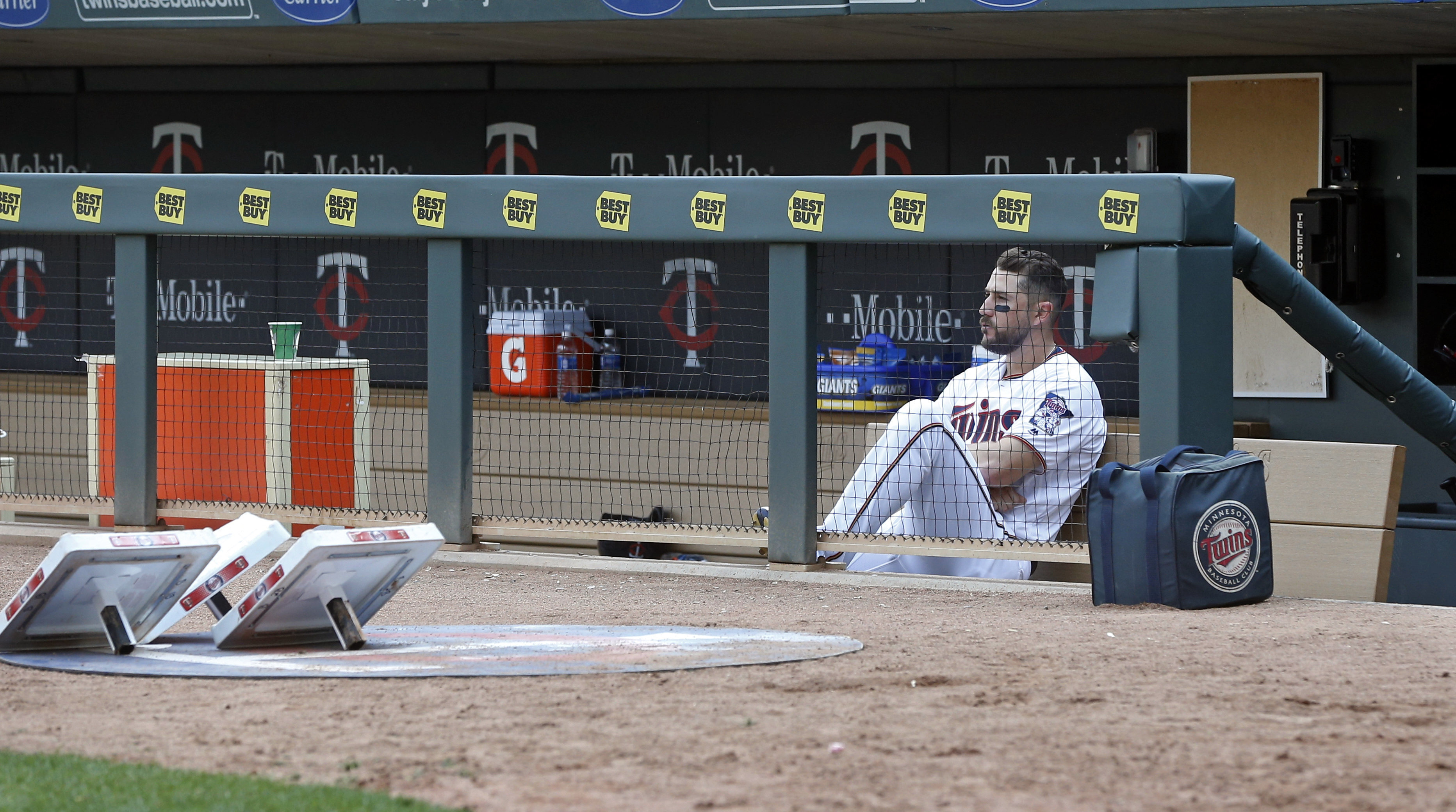Minnesota Twins' Trevor Plouffe sits alone in the dugout after the winless Twins' 3-1 loss to the Chicago White Sox in a baseball game Thursday, April 14, 2016, in Minneapolis. The loss was the ninth straight. (AP Photo/Jim Mone)