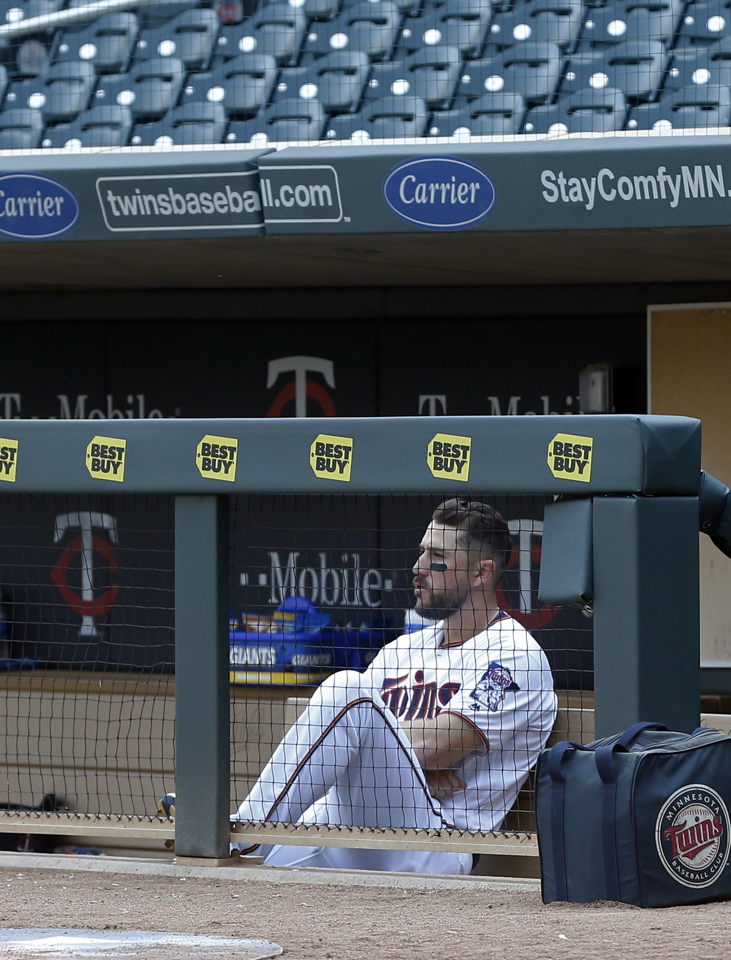 Minnesota Twins Trevor Plouffe sits alone in the dugout after the winless Twins' 3-1 loss to the Chicago White Sox in a baseball game Thursday, April 14, 2016, in Minneapolis. The loss was the ninth straight. (AP Photo/Jim Mone)