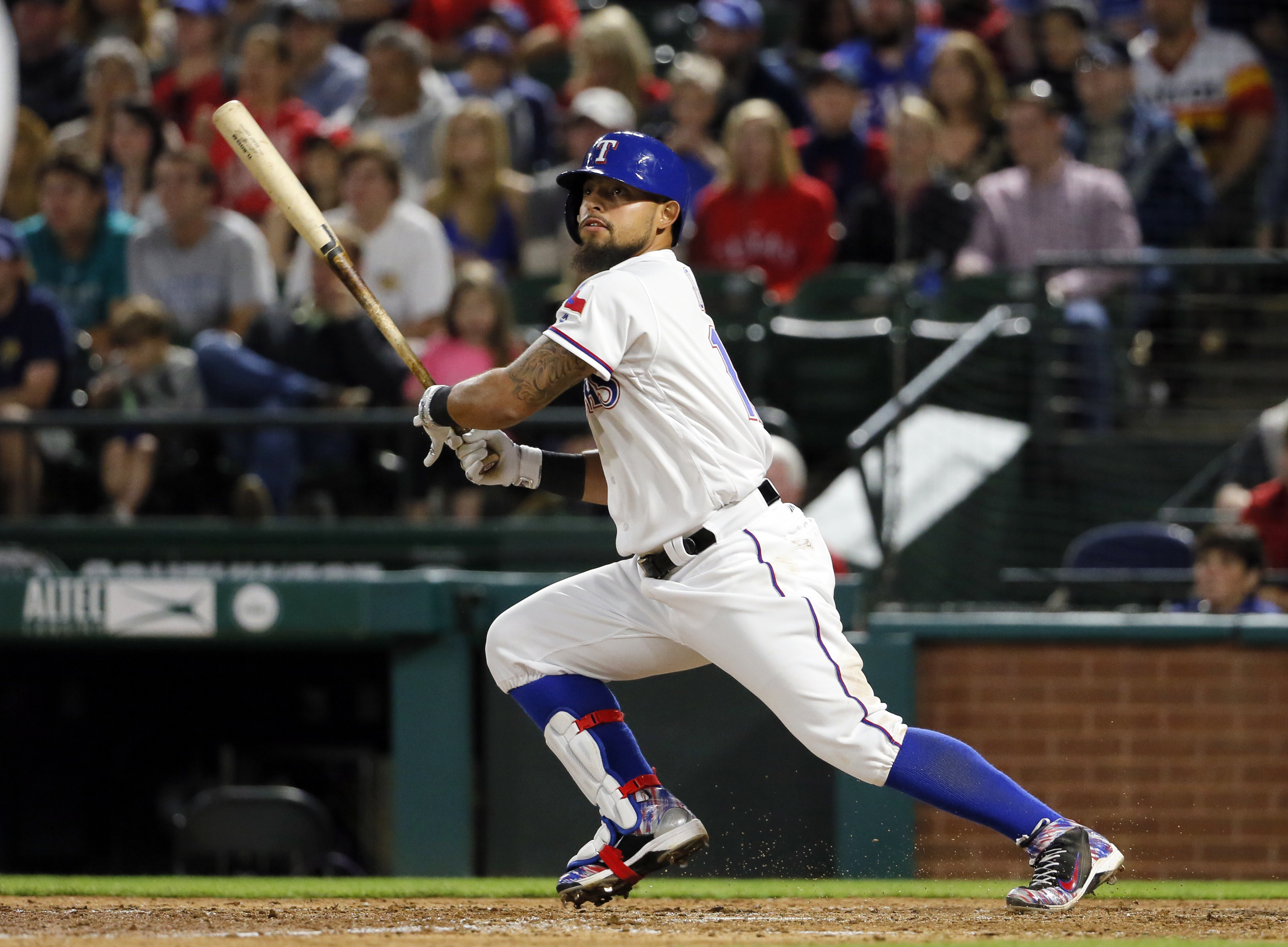Texas Rangers' Rougned Odor watches his two-run double to left off Baltimore Orioles starting pitcher Chris Tillman during the sixth inning of a baseball game Thursday, April 14, 2016, in Arlington, Texas.  (AP Photo/Tony Gutierrez)