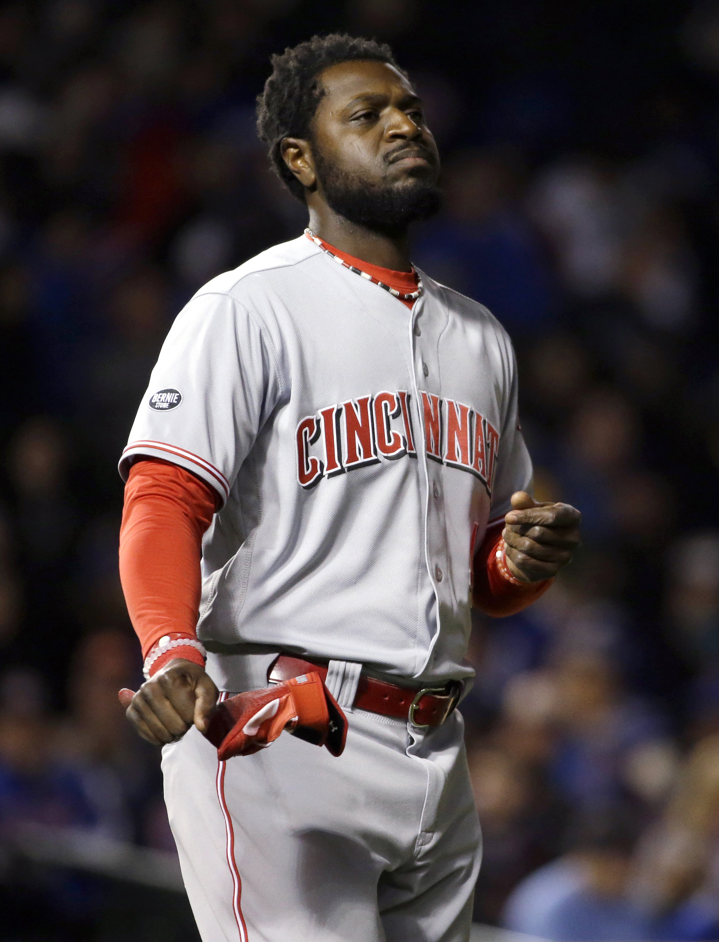 Cincinnati Reds' Brandon Phillips reacts as he walks on the field after striking out swinging during the eighth inning of a baseball game against the Chicago Cubs on Thursday, April 14, 2016, in Chicago. (AP Photo/Nam Y. Huh)