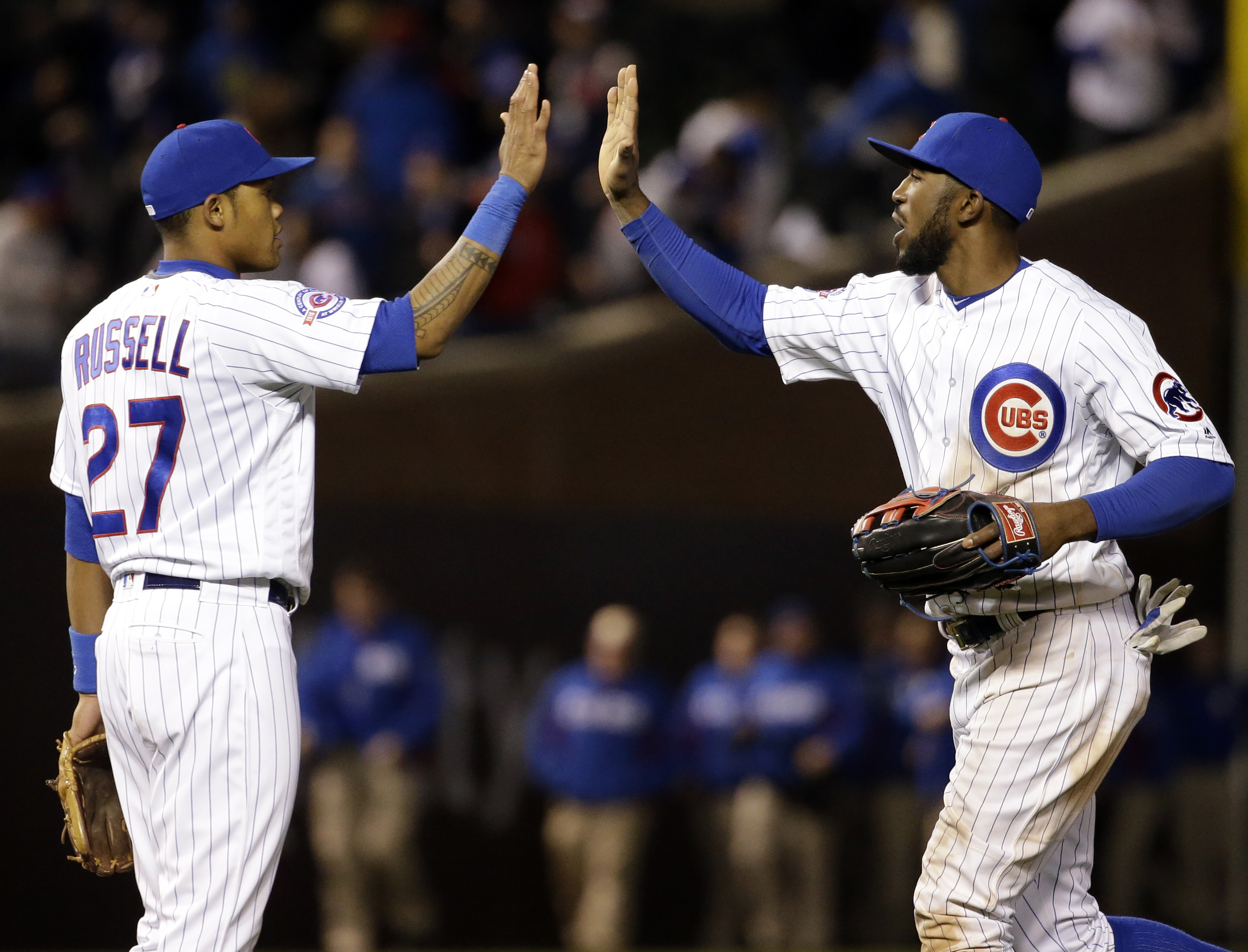 Chicago Cubs' Dexter Fowler, right, celebrates with Addison Russell after the Cubs defeated the Cincinnati Reds 8-1 in a baseball game Thursday, April 14, 2016, in Chicago. (AP Photo/Nam Y. Huh)