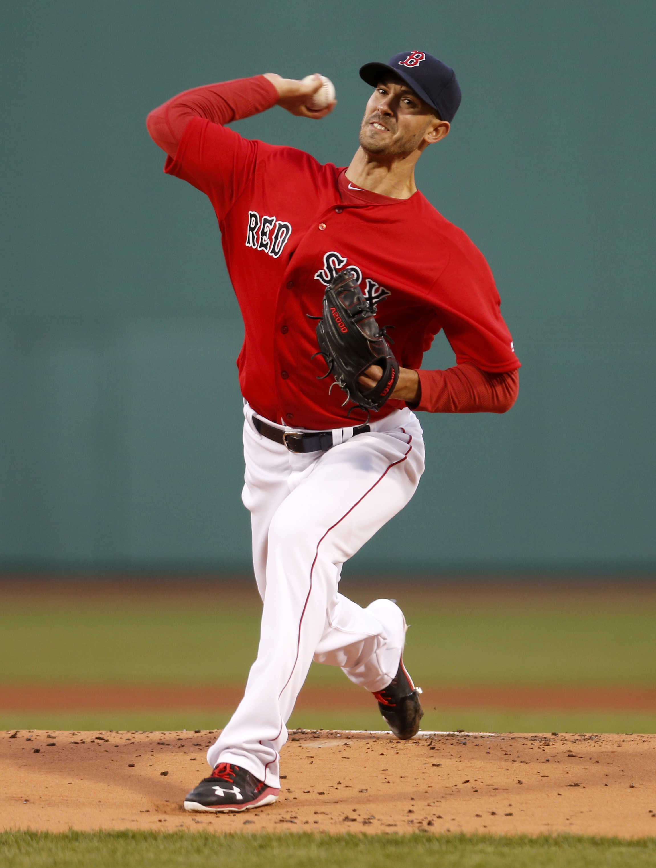 Boston Red Sox starting pitcher Rick Porcello throws during the first inning of a baseball game against the Toronto Blue Jays at Fenway Park, Friday, April 15, 2016, in Boston. (AP Photo/Mary Schwalm)