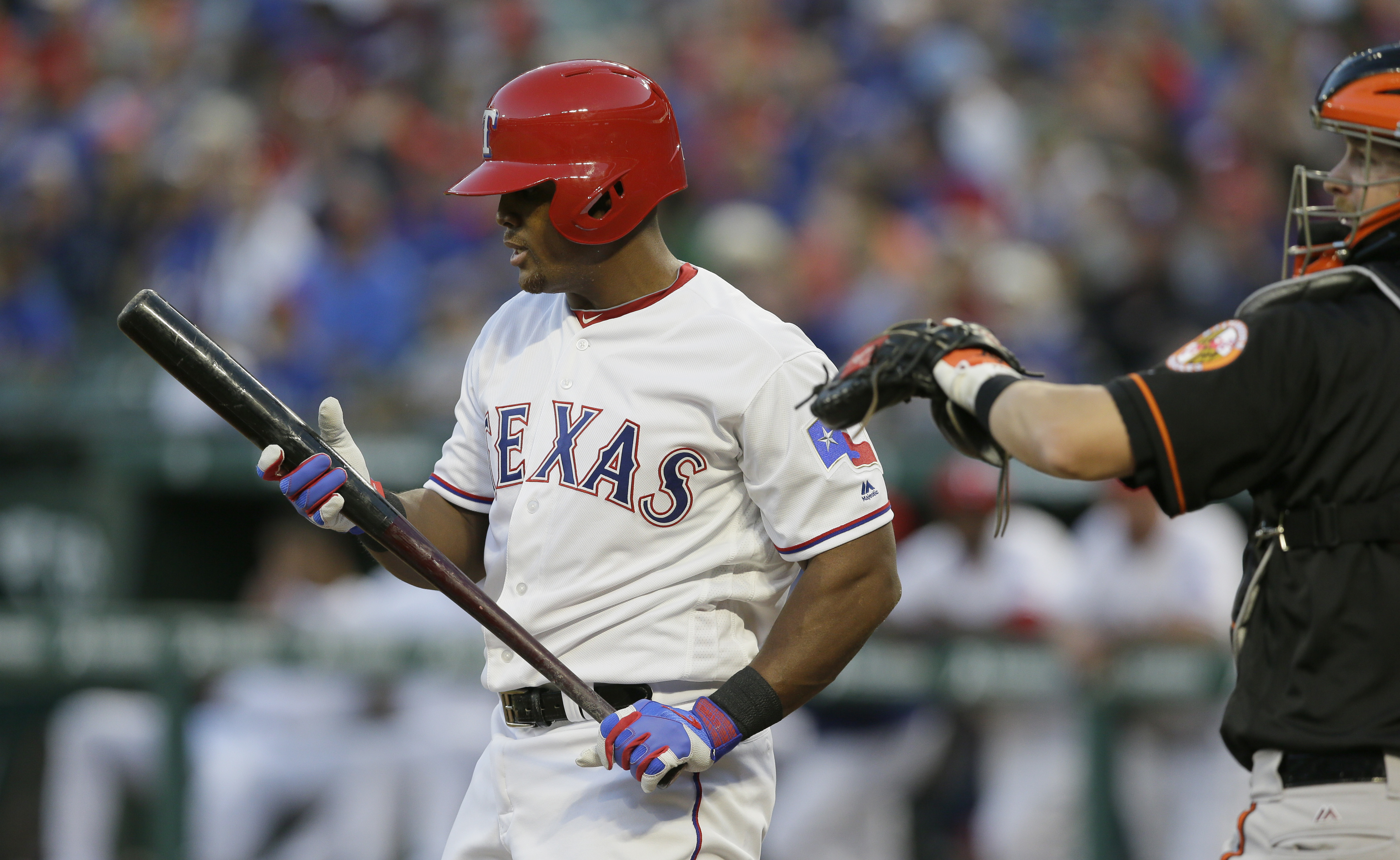 Texas Rangers' Adrian Beltre, left, prepares to bat during a baseball game against the Baltimore Orioles in Arlington, Texas, Friday, April 15, 2016. The Rangers and Beltre have reached an agreement that adds $36 million and two years for the All-Star thi