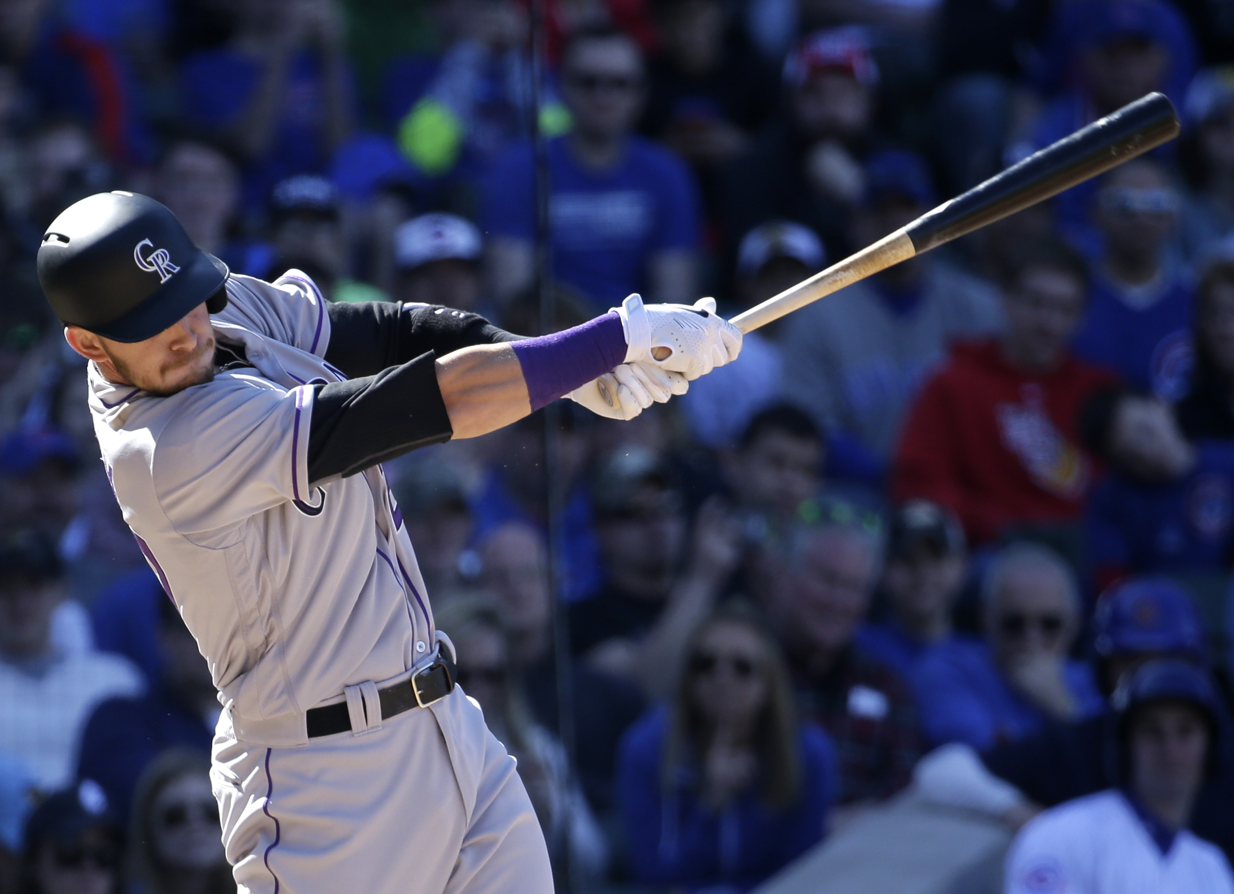Colorado Rockies' Trevor Story hits a double during the ninth inning of a baseball game against the Chicago Cubs Saturday, April 16, 2016, in Chicago. (AP Photo/Nam Y. Huh)