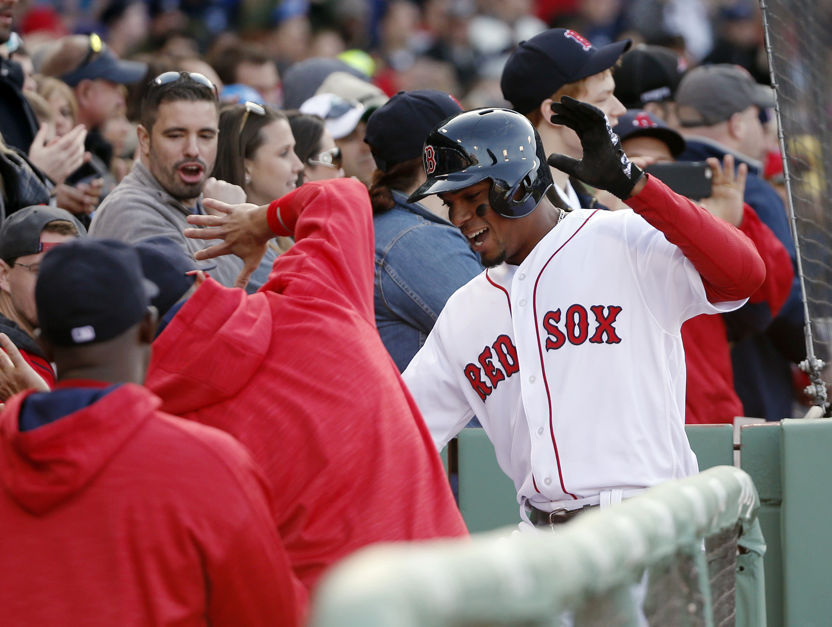 Boston Red Sox's Xander Bogaerts is congratulated at the dugout after hitting a three-run home run scoring Dustin Pedroia and Jackie Bradley Jr. during the third inning of a baseball game against the Toronto Blue Jays at Fenway Park, Saturday, April 16, 2