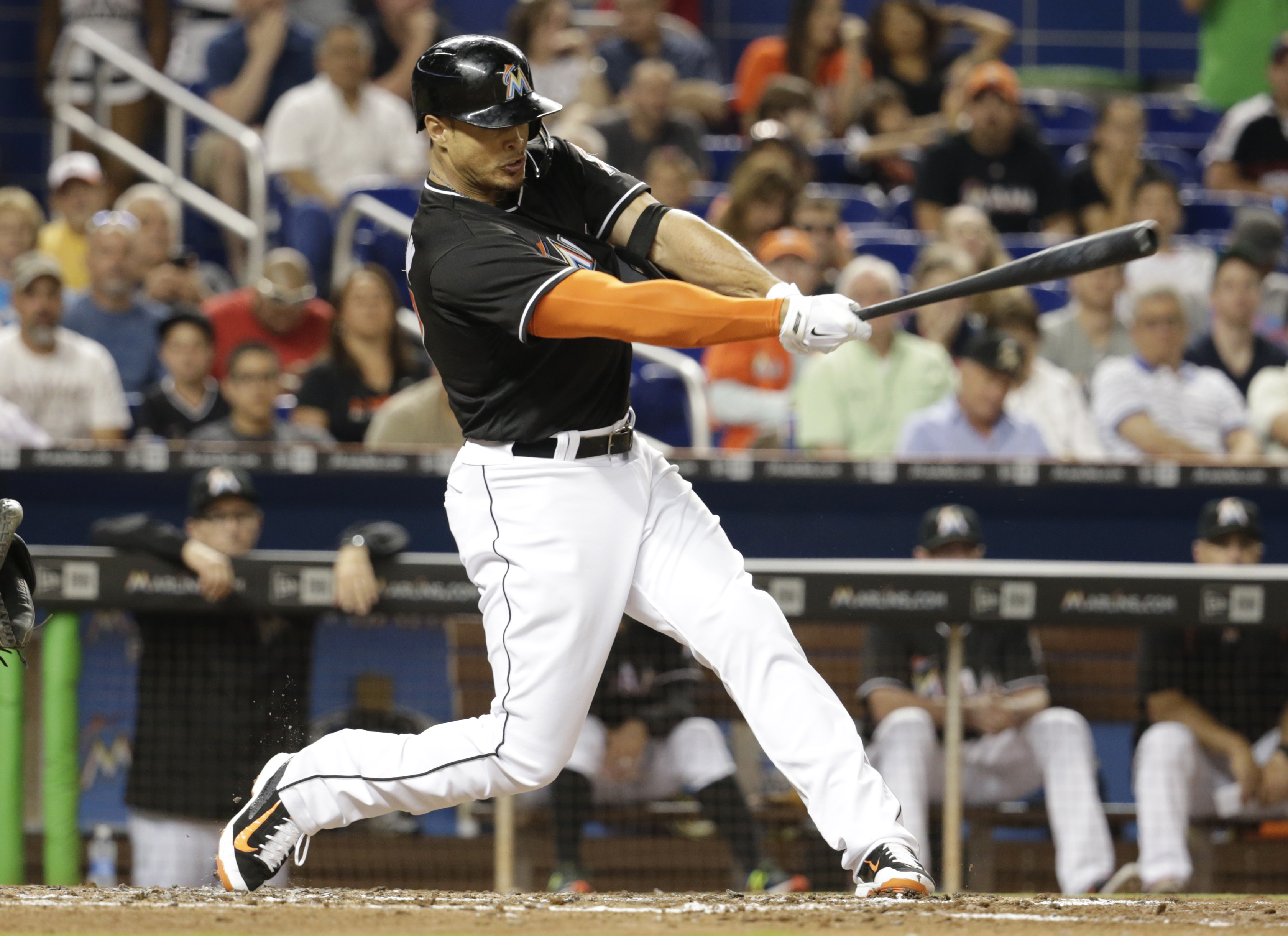 Miami Marlins' Giancarlo Stanton hits a single in the third inning of a baseball game against the Atlanta Braves, Saturday, April 16, 2016, in Miami. (AP Photo/Lynne Sladky)