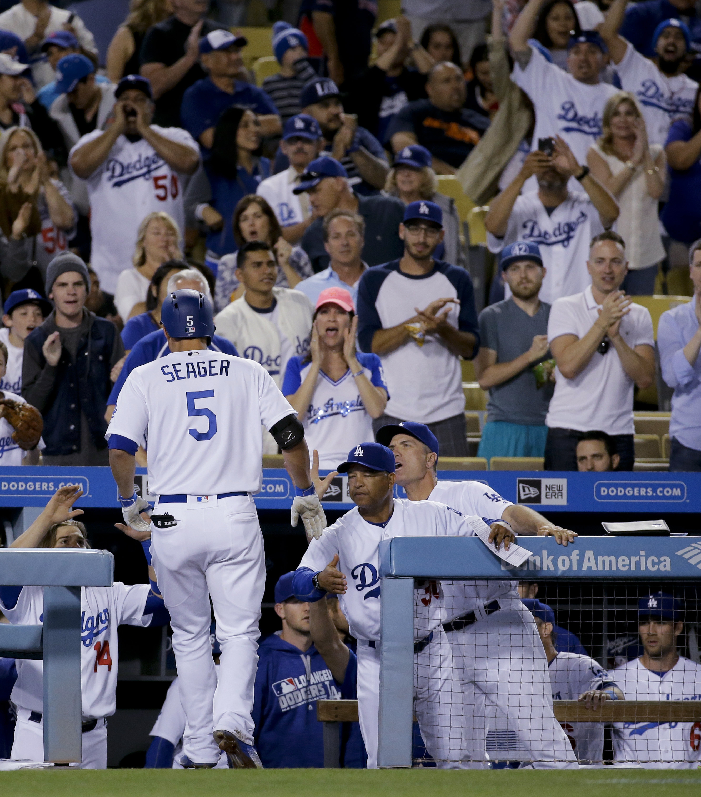 Los Angeles Dodgers' Corey Seager, celebrates after a two-run home run against the San Francisco Giants during the eighth inning of a baseball game in Los Angeles, Saturday, April 16, 2016. (AP Photo/Chris Carlson)