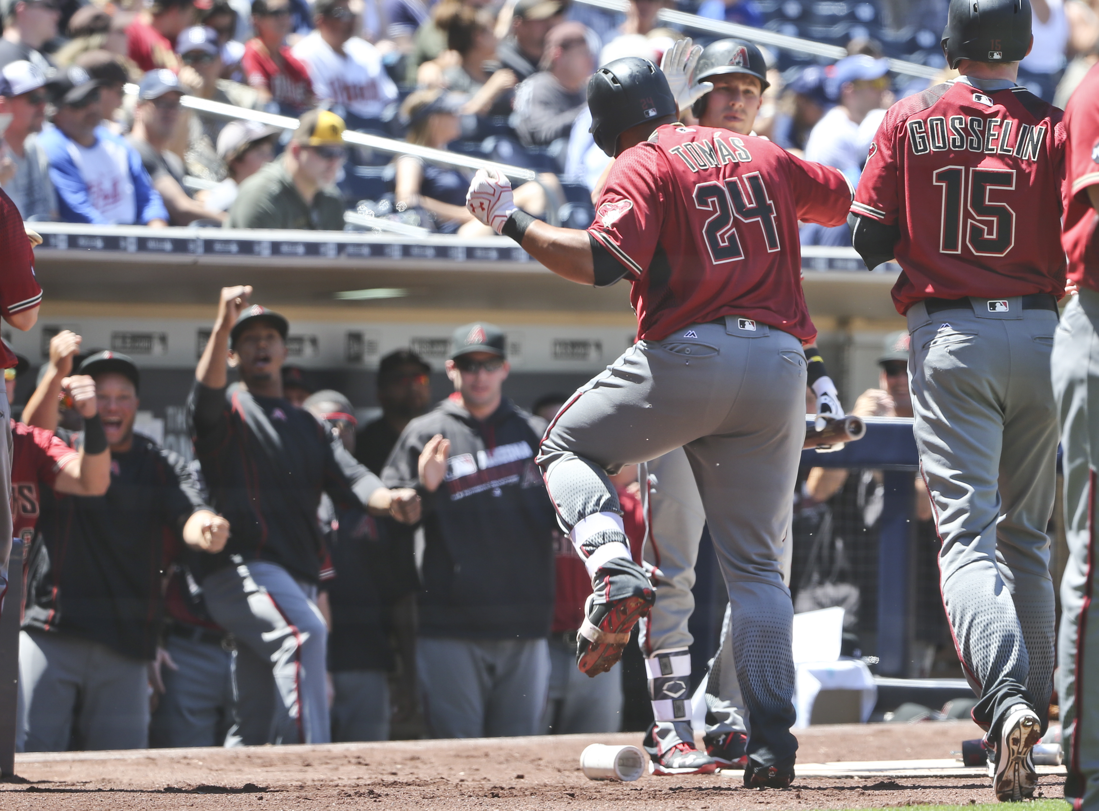 Arizona Diamondbacks' Yasmany Tomas dances while returning to the dugout after his two-run home run against the San Diego Padres in the first inning of a baseball game Sunday, April 17, 2016, in San Diego. (AP Photo/Lenny Ignelzi)