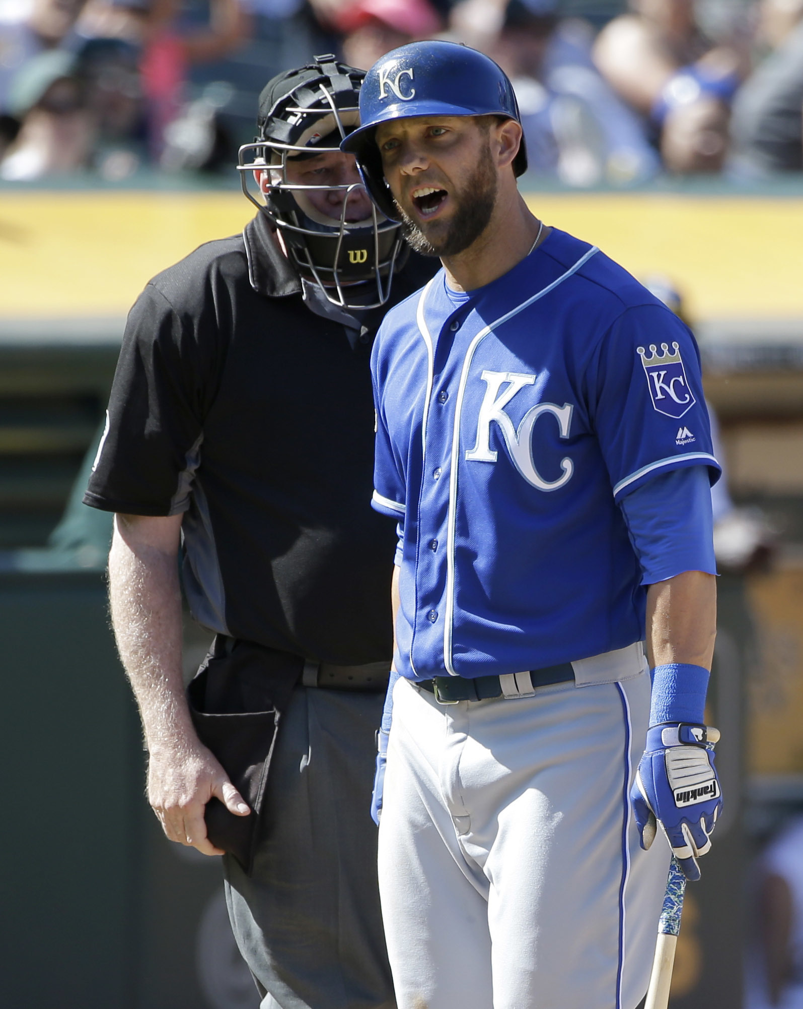 Kansas City Royals' Alex Gordon, right, argues with home plate umpire Quinn Wolcott after being called out on strikes during the ninth inning of a baseball game against the Oakland Athletics, Sunday, April 17, 2016, in Oakland, Calif. (AP Photo/Marcio Jos