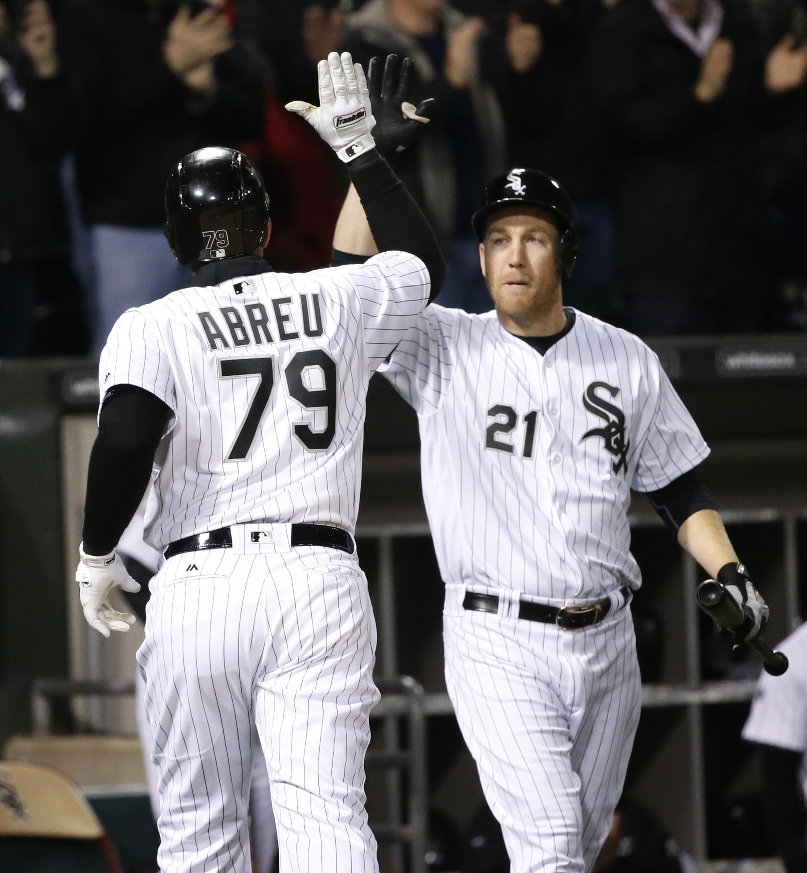 Chicago White Sox's Jose Abreu, left, celebrates his home run off Los Angeles Angels starting pitcher Matt Shoemaker with Todd Frazier during the fourth inning of a baseball game Tuesday, April 19, 2016, in Chicago. (AP Photo/Charles Rex Arbogast)