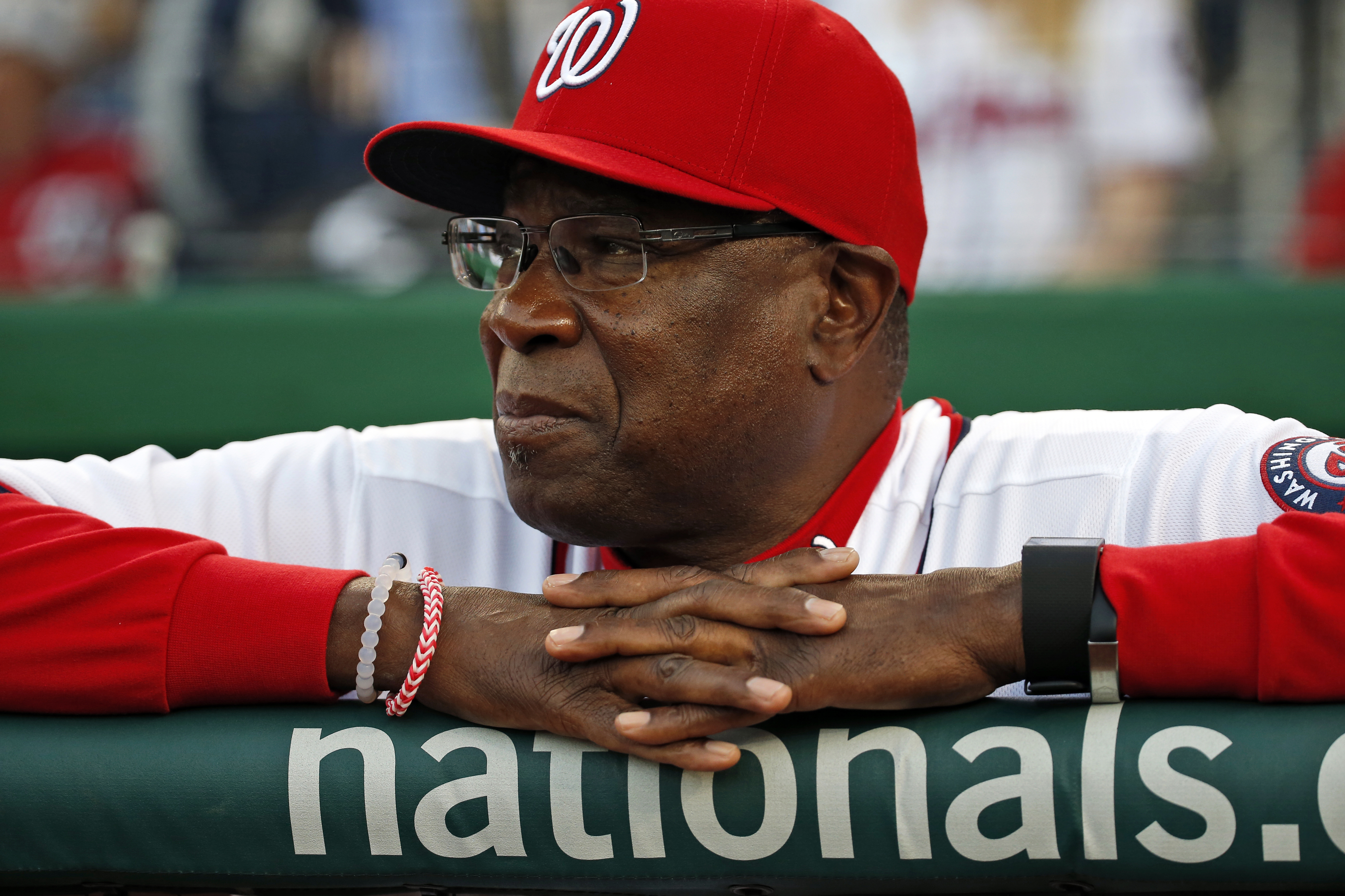 In this photo taken April 11, 2016, Washington Nationals manager Dusty Baker pauses before a baseball game against the Atlanta Braves at Nationals Park in Washington. Major League Baseball teams could do a better job hiring minority candidates for managin