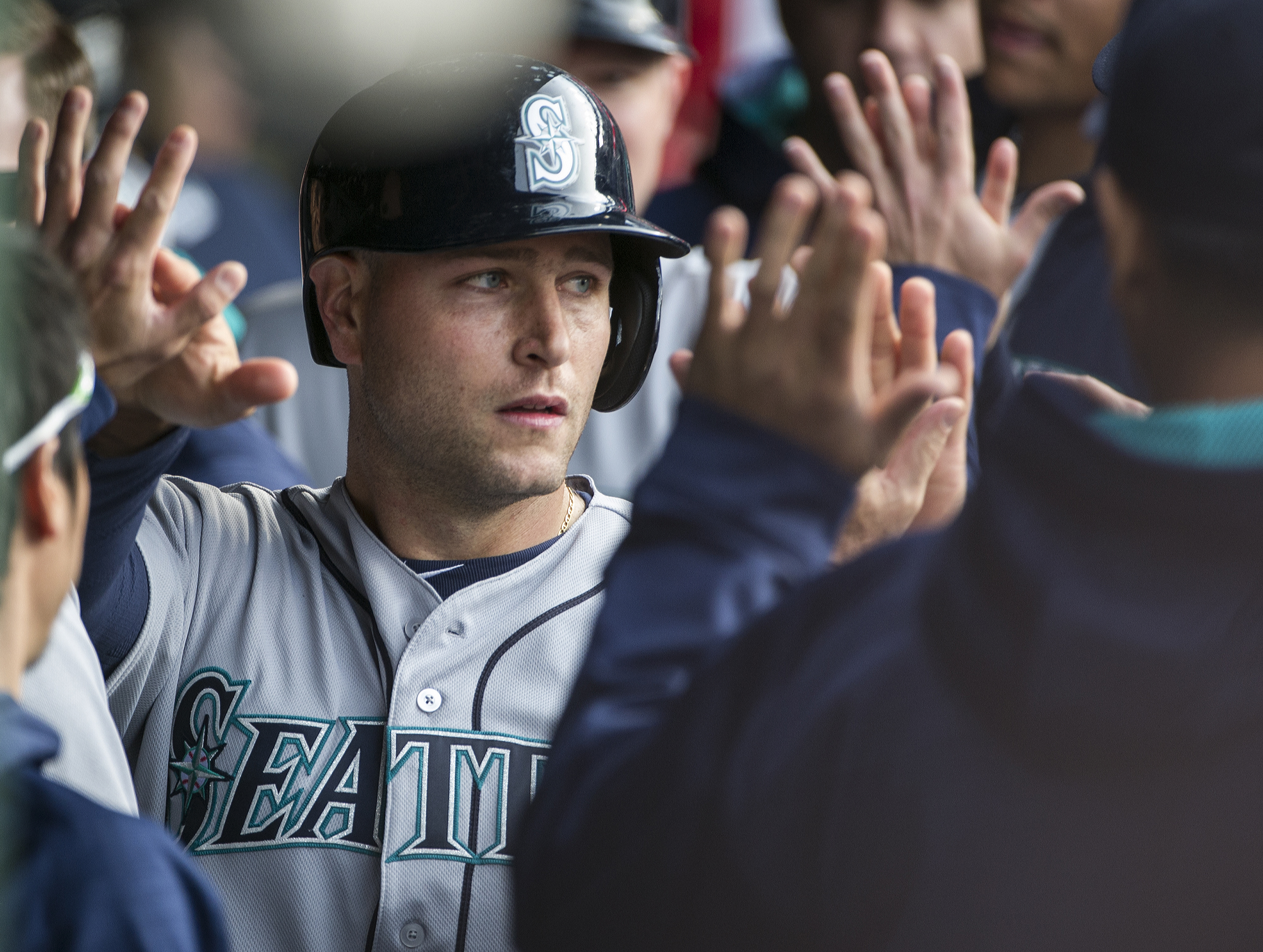 Seattle Mariners Chris Iannetta is congratulated after scoring on a hit by the Mariners Norichika Aoki during the second inning of a baseball game against the Cleveland Indians, in Cleveland, Wednesday, April 20, 2016. (AP Photo/Phil Long)