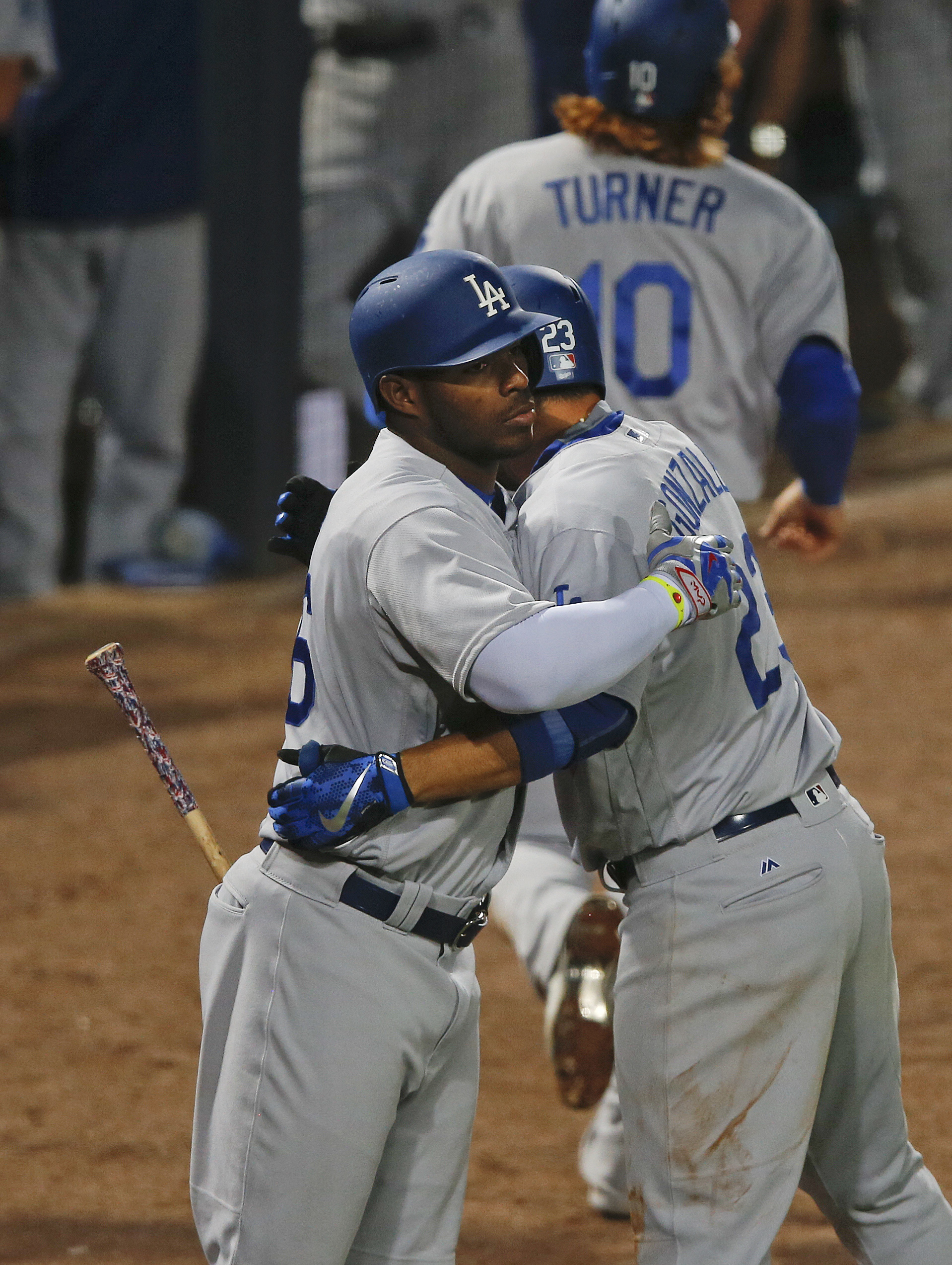 Los Angeles Dodgers' Adrian Gonzalez, right, celebrates with on-deck batter Yasiel Puig (66) after hitting a two-run home in the sixth inning of a baseball game against the Atlanta Braves on Wednesday, April 20, 2016, in Atlanta. (AP Photo/John Bazemore)