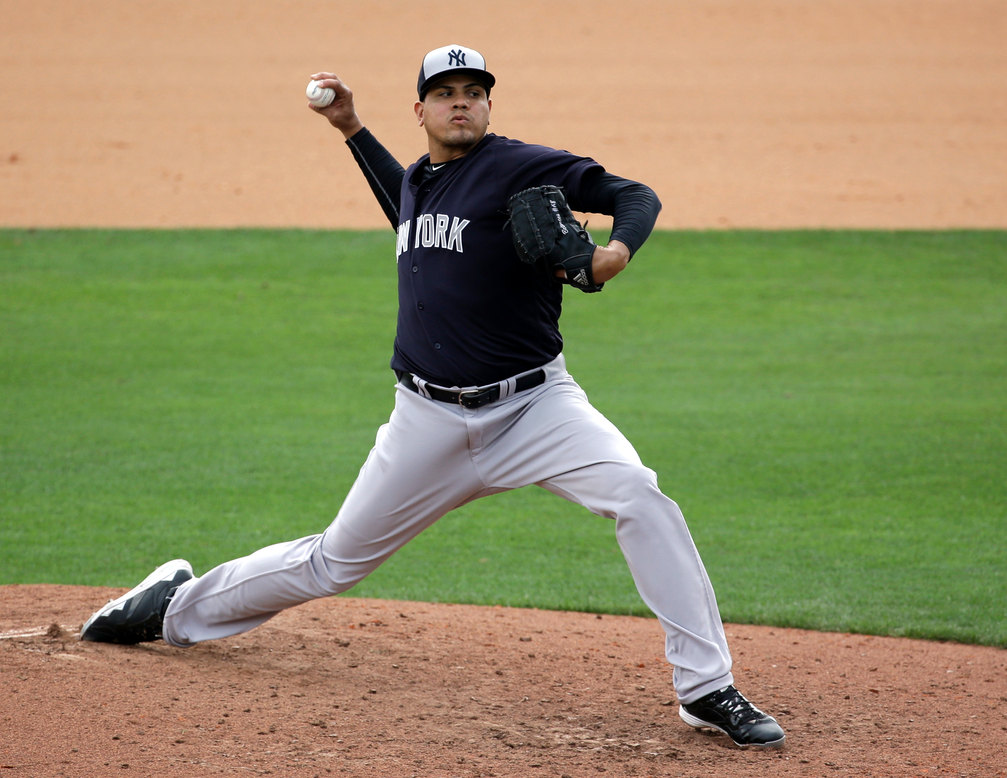 FILE- In this March 30, 2016, file photo, New York Yankees' Dellin Betances pitches against the Atlanta Braves in the seventh inning of a spring training baseball game in Kissimmee, Fla. Betances and Andrew Miller, the Yankees' dynamic duo of late-inning