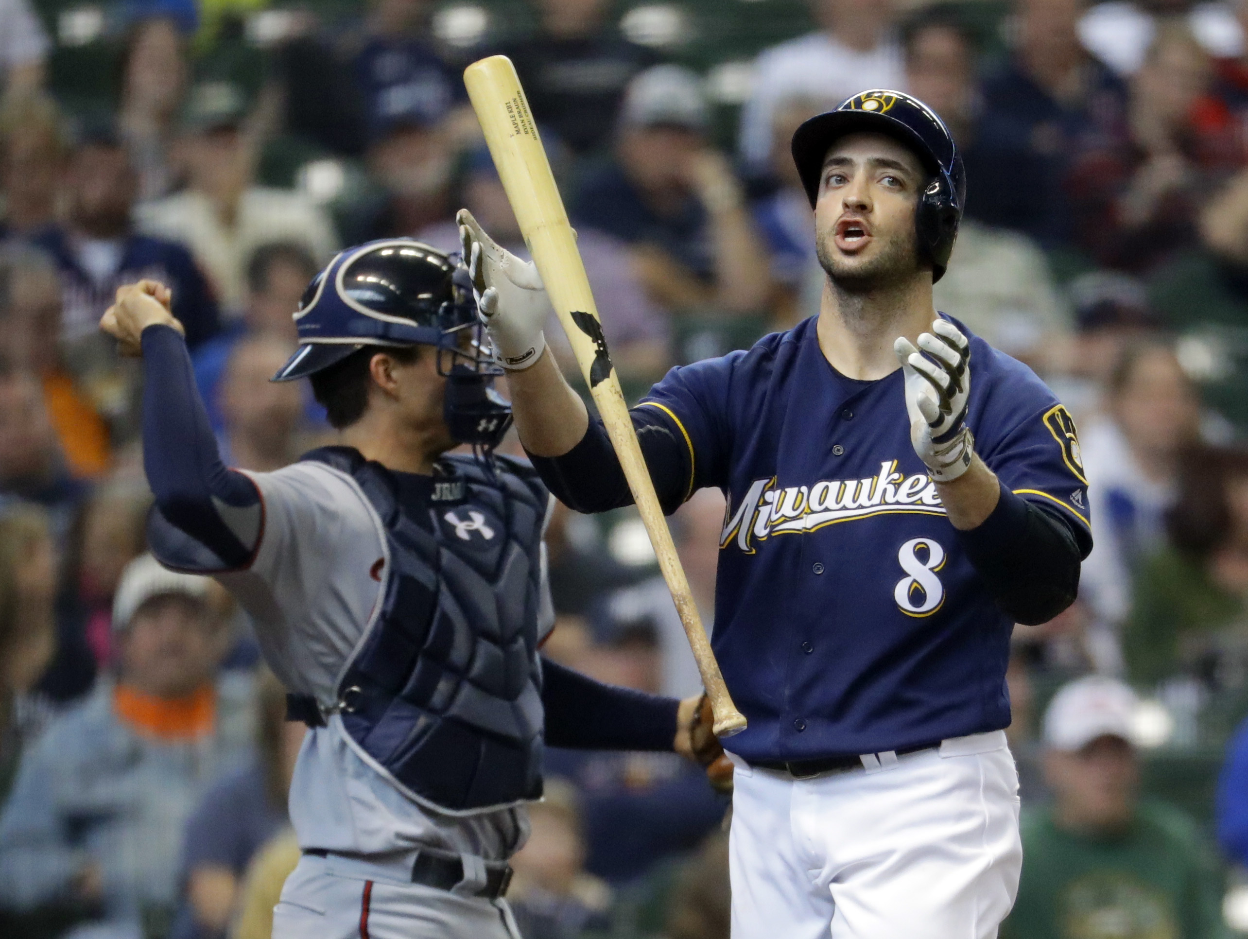 Milwaukee Brewers' Ryan Braun flips his bat after striking out during the sixth inning of a baseball game against the Minnesota Twins Thursday, April 21, 2016, in Milwaukee. (AP Photo/Morry Gash)
