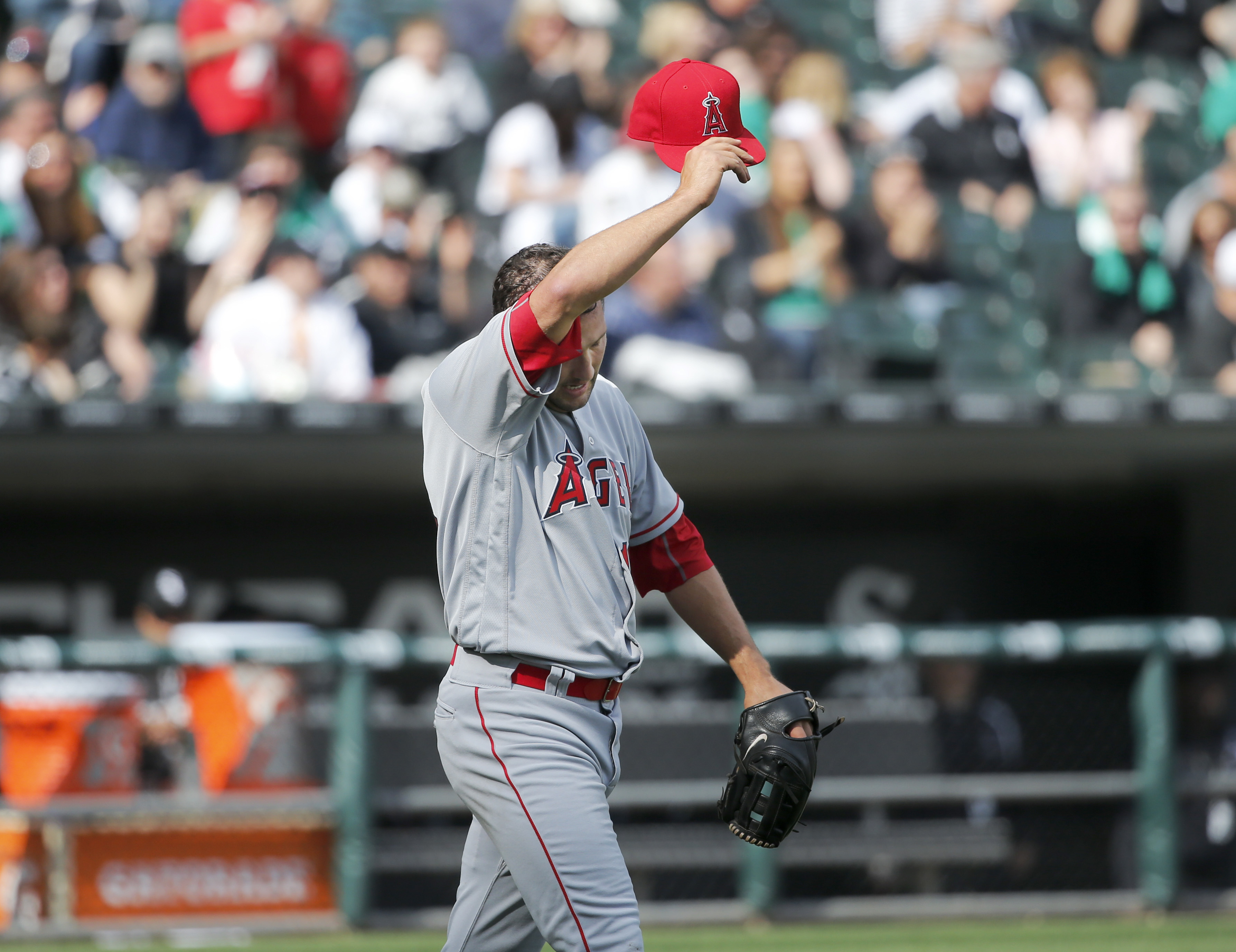 Los Angeles Angels relief pitcher Huston Street wipes his face as he get into a jam during the ninth inning of a baseball game against the Chicago White Sox, Thursday, April 21, 2016, in Chicago. Street recovered and the Angels won 3-2. (AP Photo/Charles