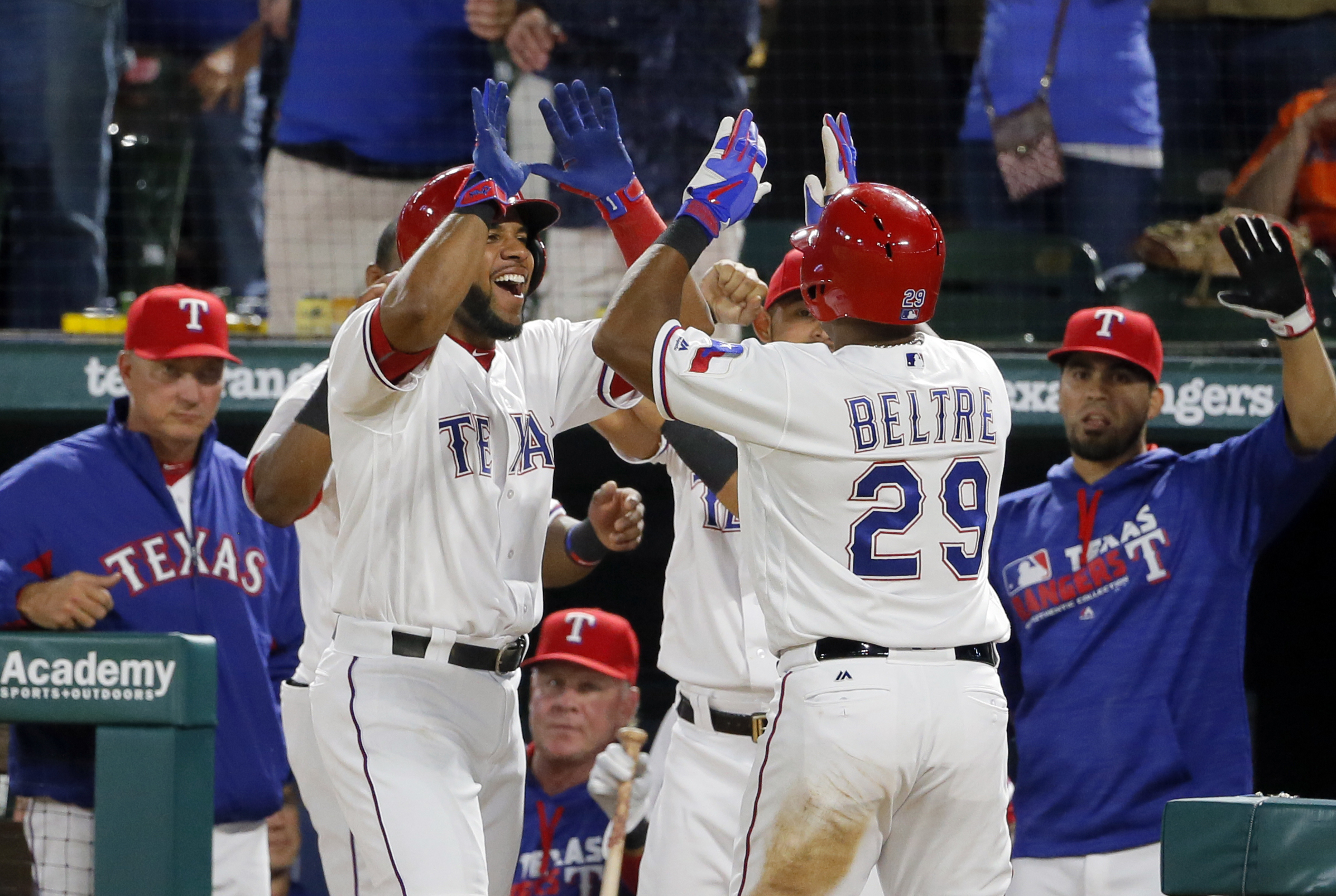 Texas Rangers' Elvis Andrus, left, congratulates Adrian Beltre (29) on his solo home run during the seventh inning of a baseball game against the Houston Astros on Thursday, April 21, 2016, in Arlington, Texas. The shot came off of Astros relief pitcher P