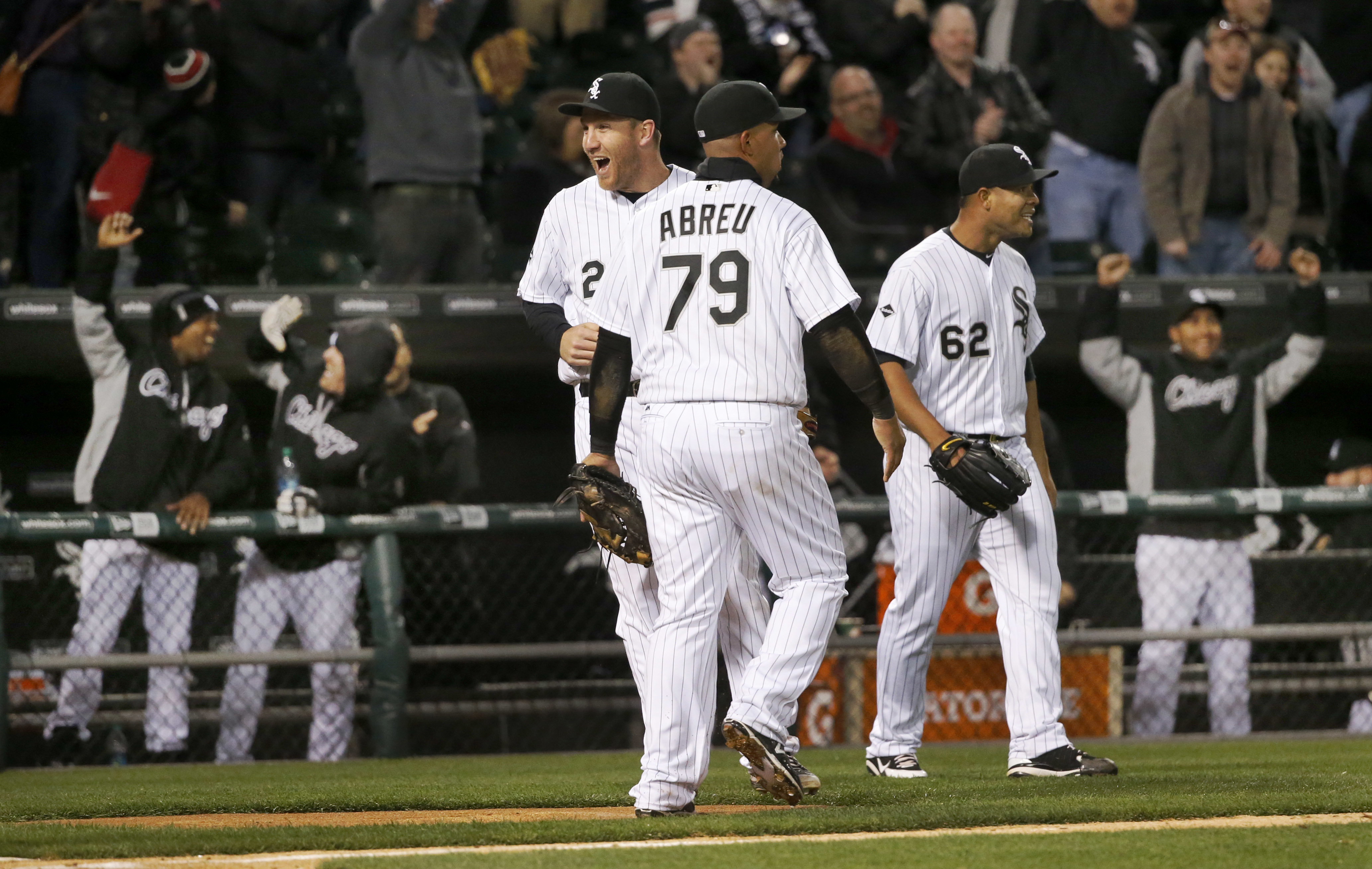 Chicago White Sox players celebrate after converting a triple play with the bases loaded during the seventh inning of a baseball game against the Texas Rangers, Friday, April 22, 2016, in Chicago. (AP Photo/Charles Rex Arbogast)