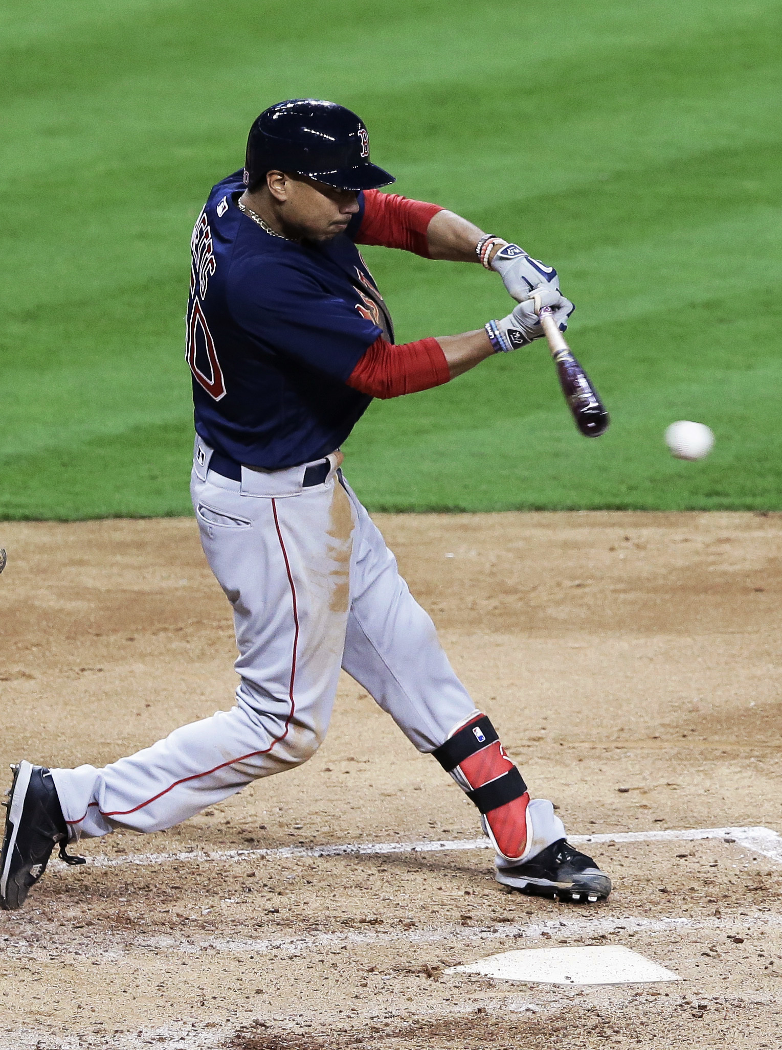 Boston Red Sox's Mookie Betts hits a single against the Houston Astros during the fourth inning of a baseball game Friday, April 22, 2016, in Houston. (AP Photo/Pat Sullivan)