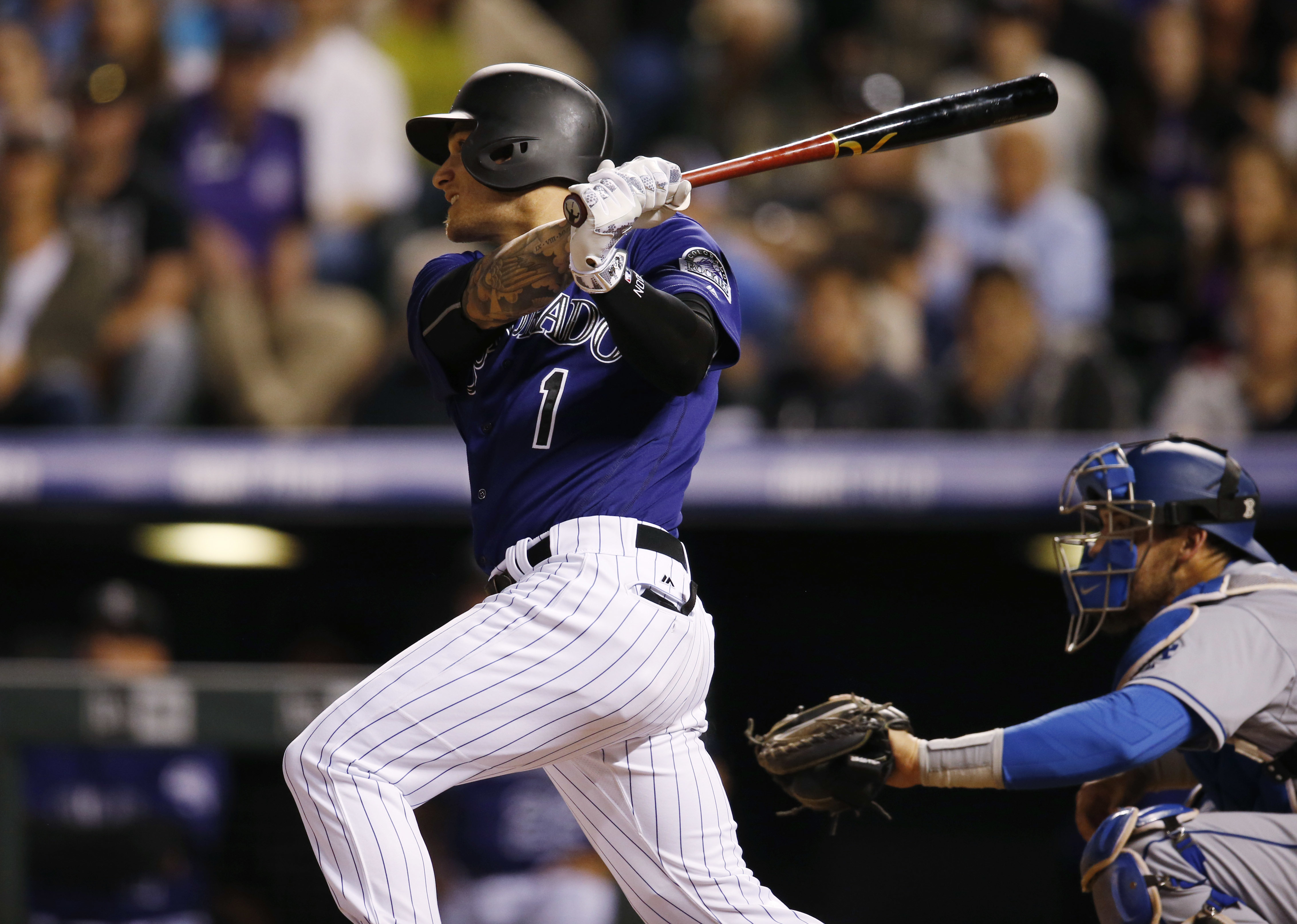 Colorado Rockies' Brandon Barnes watches his two-run triple off Los Angeles Dodgers relief pitcher Chris Hatcher during the eighth inning of a baseball game Friday, April 22, 2016, in Denver. (AP Photo/David Zalubowski)