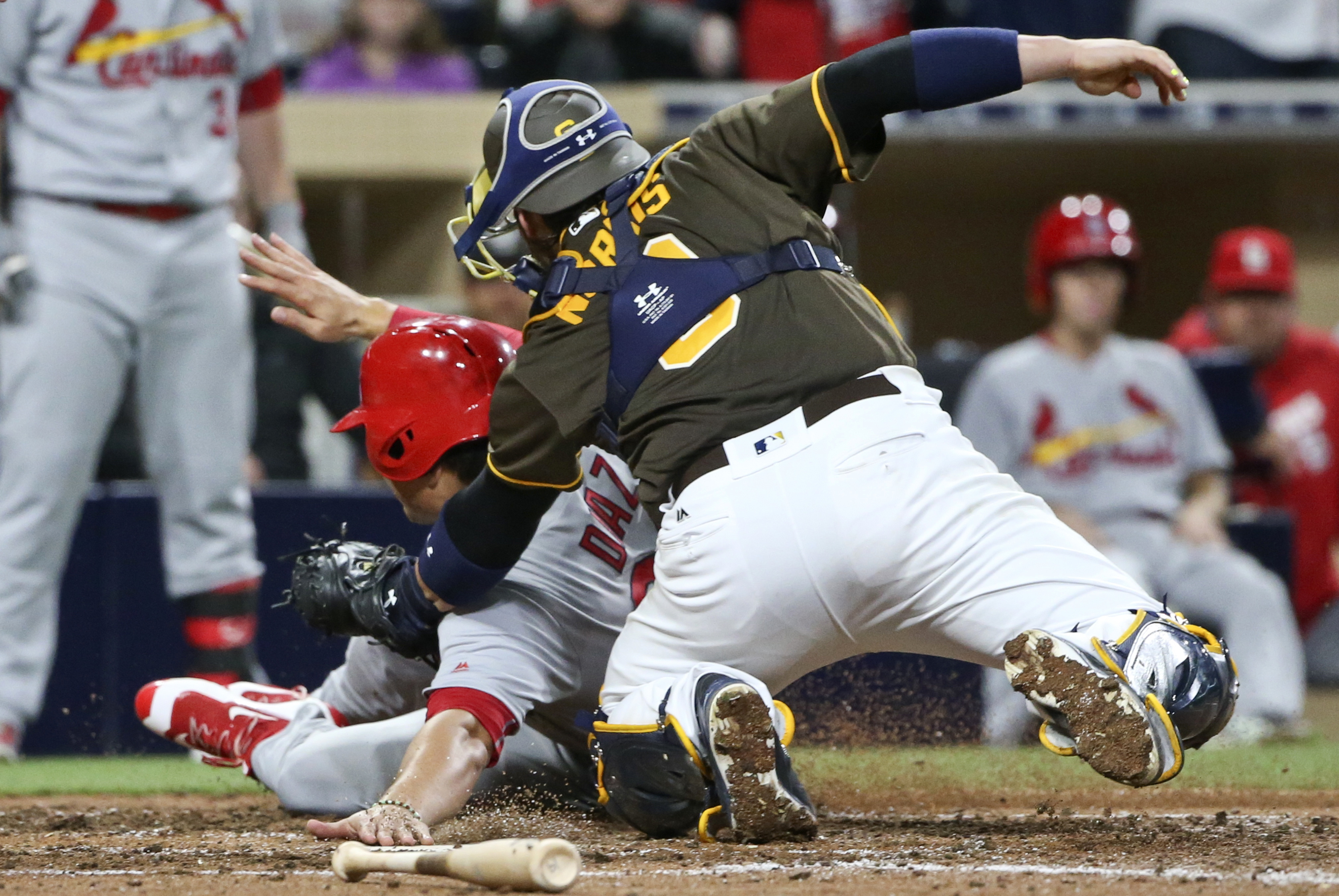 St. Louis Cardinals' Aledmys Diazis is tagged out at home by San Diego Padres catcher Derek Norris during the seventh inning of a baseball game Friday, April 22, 2016, in San Diego. (AP Photo/Lenny Ignelzi)