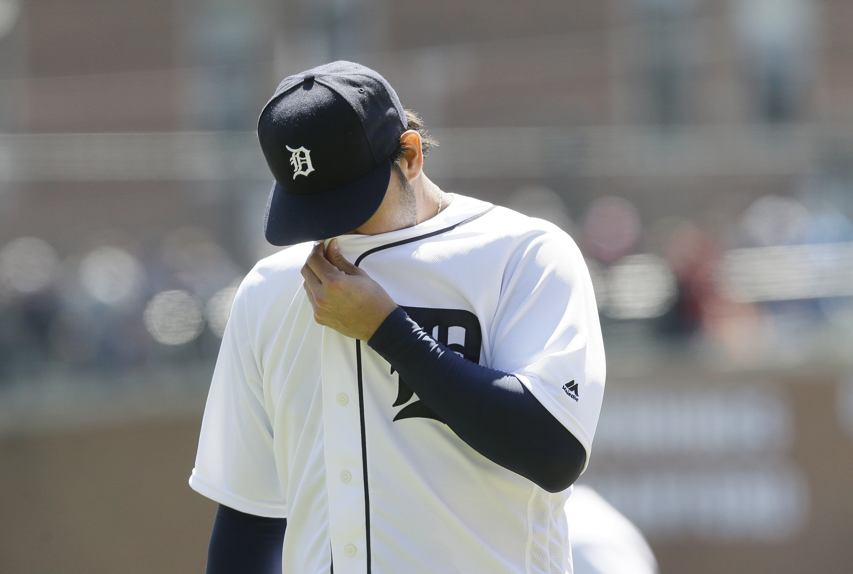 Detroit Tigers starting pitcher Anibal Sanchez wipes his face as he walks back to the dugout during the first inning of a baseball game against the Cleveland Indians, Saturday, April 23, 2016, in Detroit. Sanchez gave up three runs to the Indians in the i