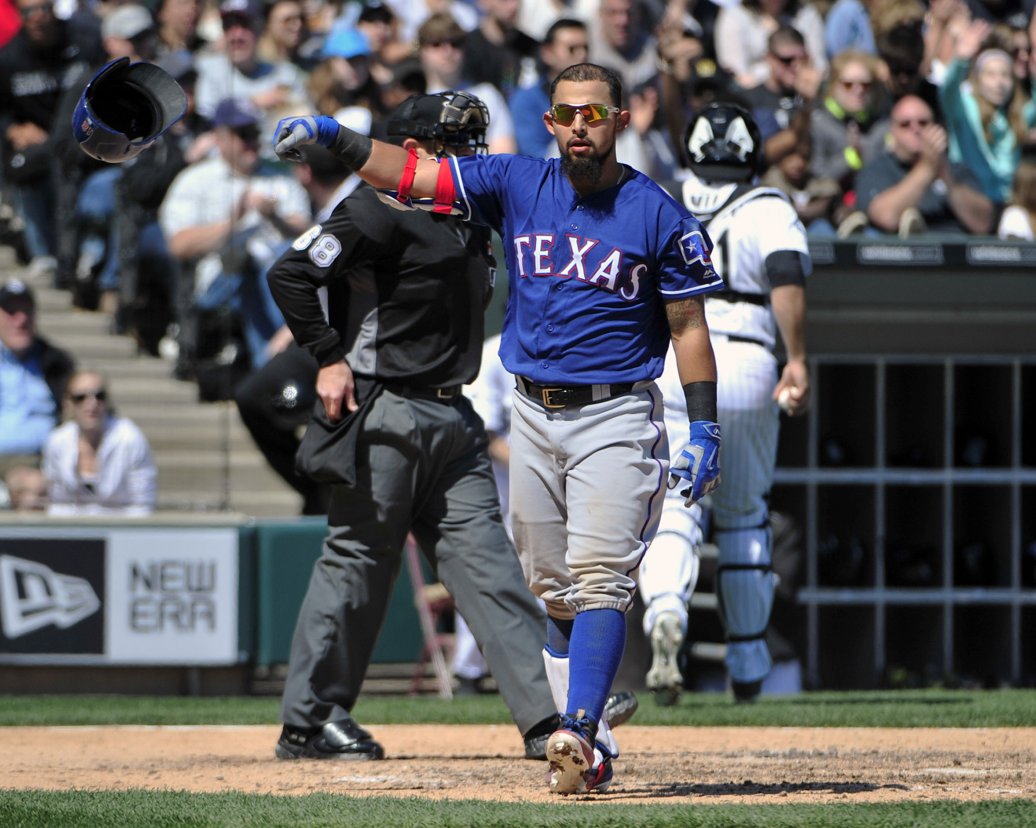 Texas Rangers' Rougned Odor (12) reacts after striking out against the Chicago White Sox during the fifth inning of a baseball game, Saturday, April 23, 2016, in Chicago. (AP Photo/David Banks)