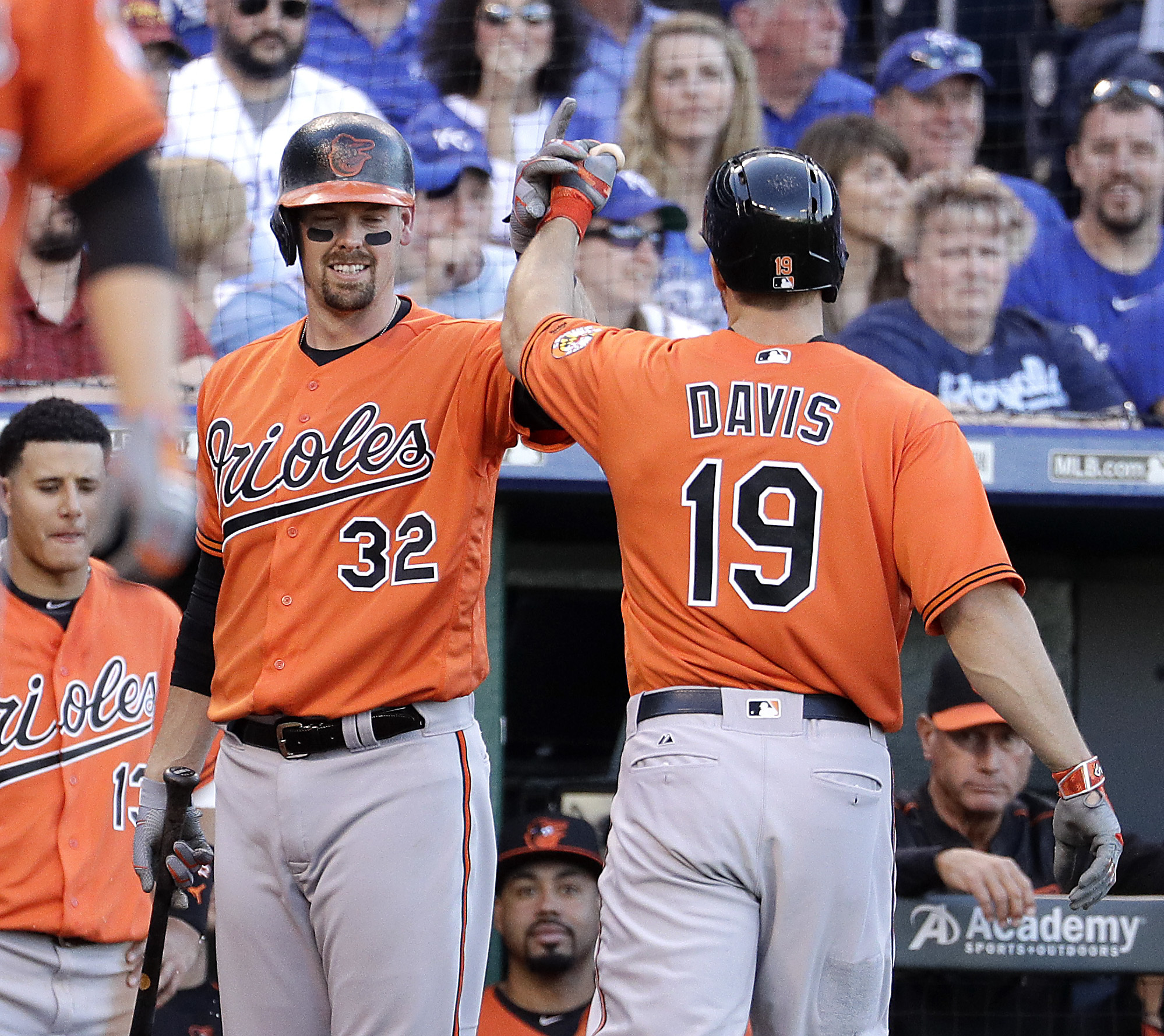Baltimore Orioles' Chris Davis (19) celebrates with Matt Wieters (32) after Davis hit a solo home run during the second inning of a baseball game against the Kansas City Royals Saturday, April 23, 2016, in Kansas City, Mo. (AP Photo/Charlie Riedel)