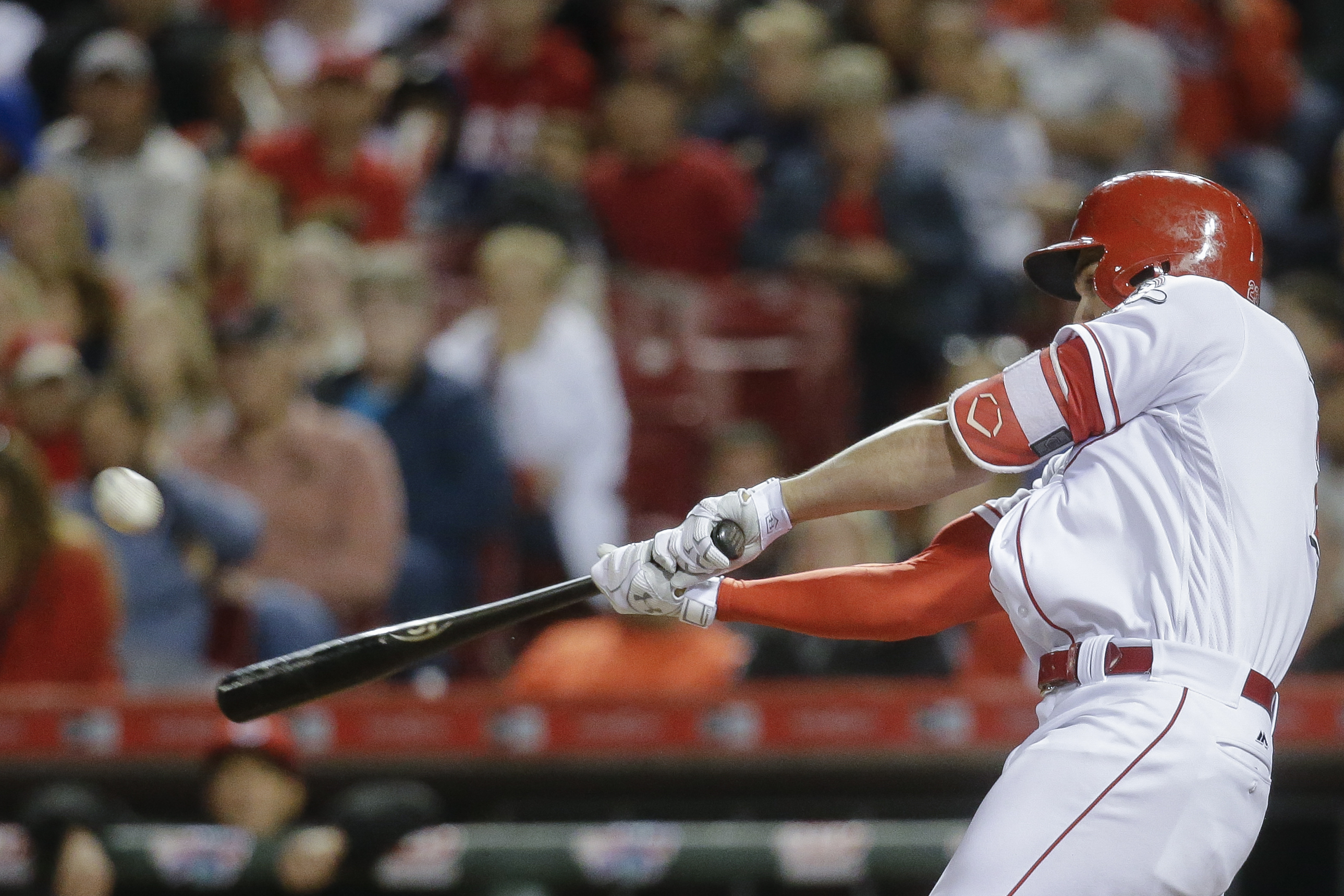 Cincinnati Reds' Adam Duvall hits a three-run home run off Chicago Cubs relief pitcher Trevor Cahill in the sixth inning of a baseball game, Saturday, April 23, 2016, in Cincinnati. (AP Photo/John Minchillo)