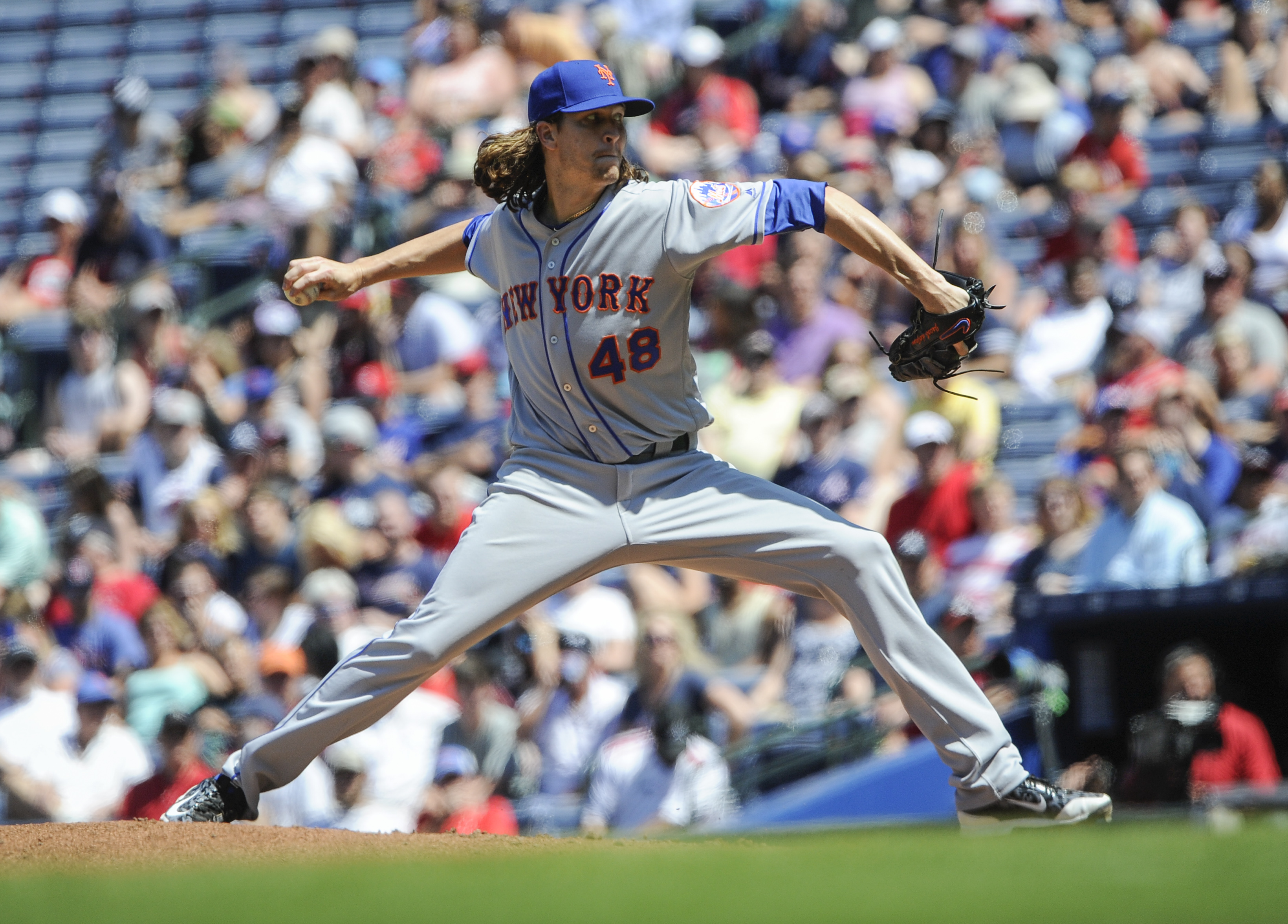 New York Mets' Jacob deGrom delivers a pitch against the Atlanta Braves during the sixth inning of a baseball game, Sunday, April 24, 2016, in Atlanta. (AP Photo/John Amis)