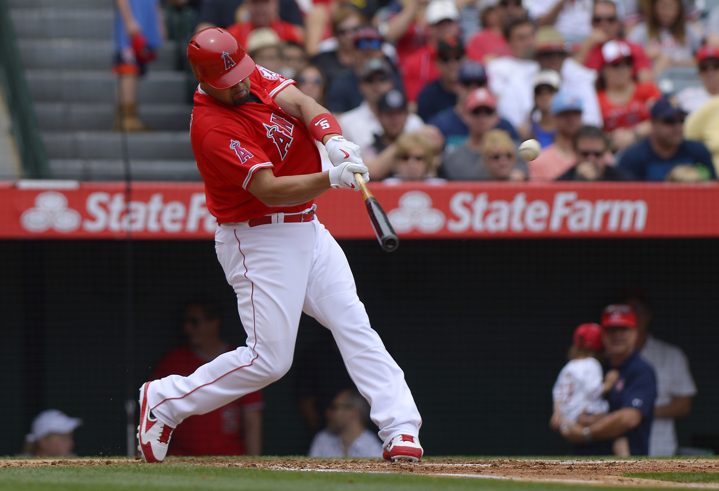 Los Angeles Angels' Albert Pujols hits a two-run home run during the first inning of a baseball game against the Seattle Mariners, Sunday, April 24, 2016, in Anaheim, Calif. (AP Photo/Mark J. Terrill)