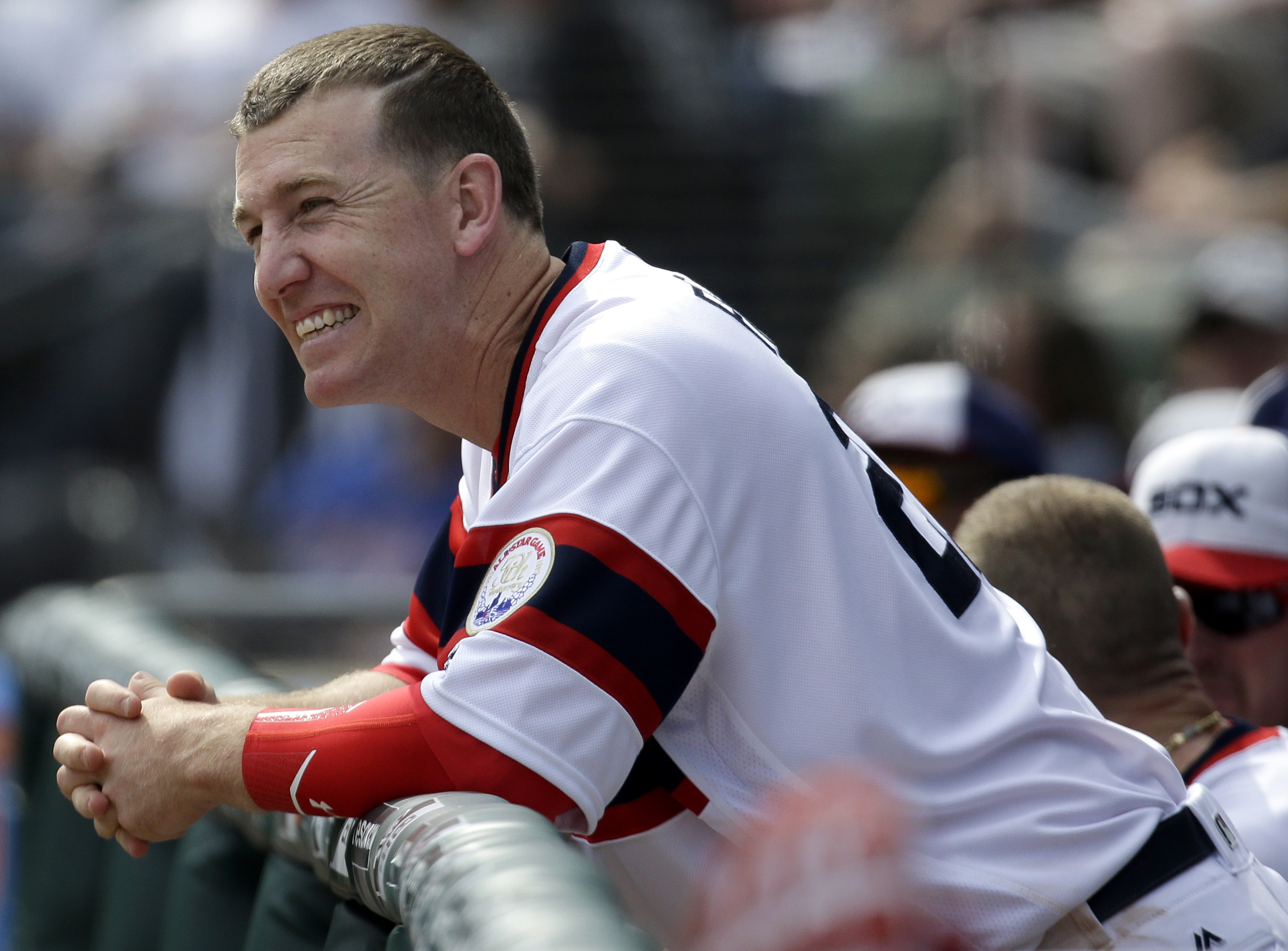Chicago White Sox's Todd Frazier smiles as he watches teammates during the seventh inning of a baseball game against the Texas Rangers, Sunday, April 24, 2016, in Chicago. (AP Photo/Nam Y. Huh)