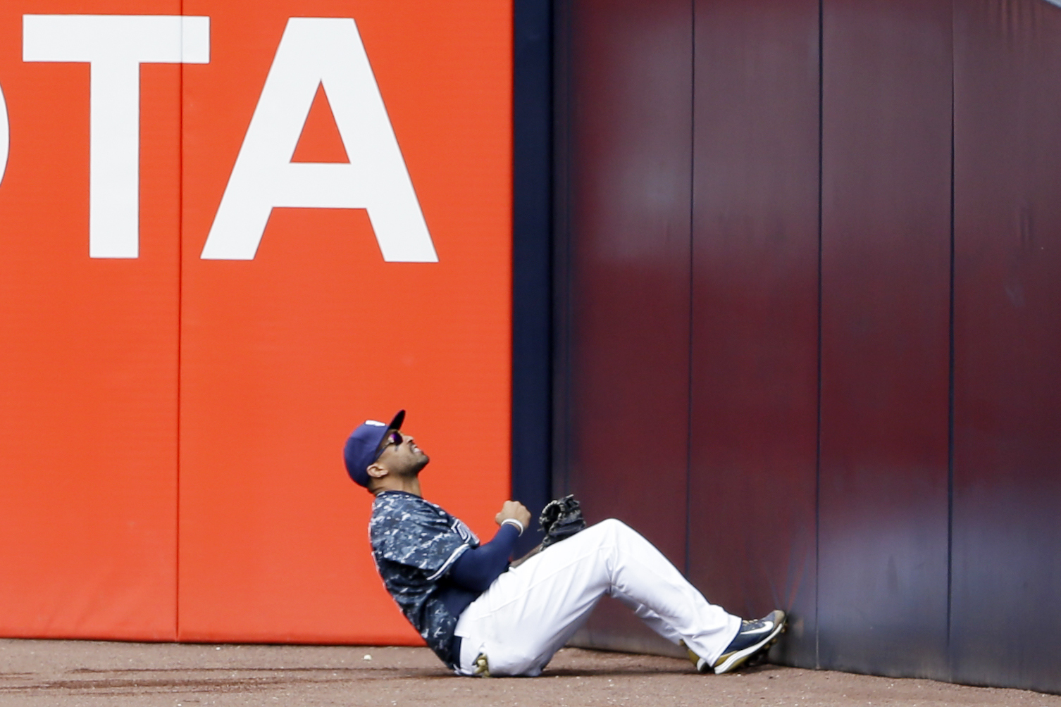 San Diego Padres right fielder Matt Kemp reacts after missing the catch on a foul ball from St. Louis Cardinals' Stephen Piscotty during the sixth inning of a baseball game Sunday, April 24, 2016, in San Diego. (AP Photo/Gregory Bull)