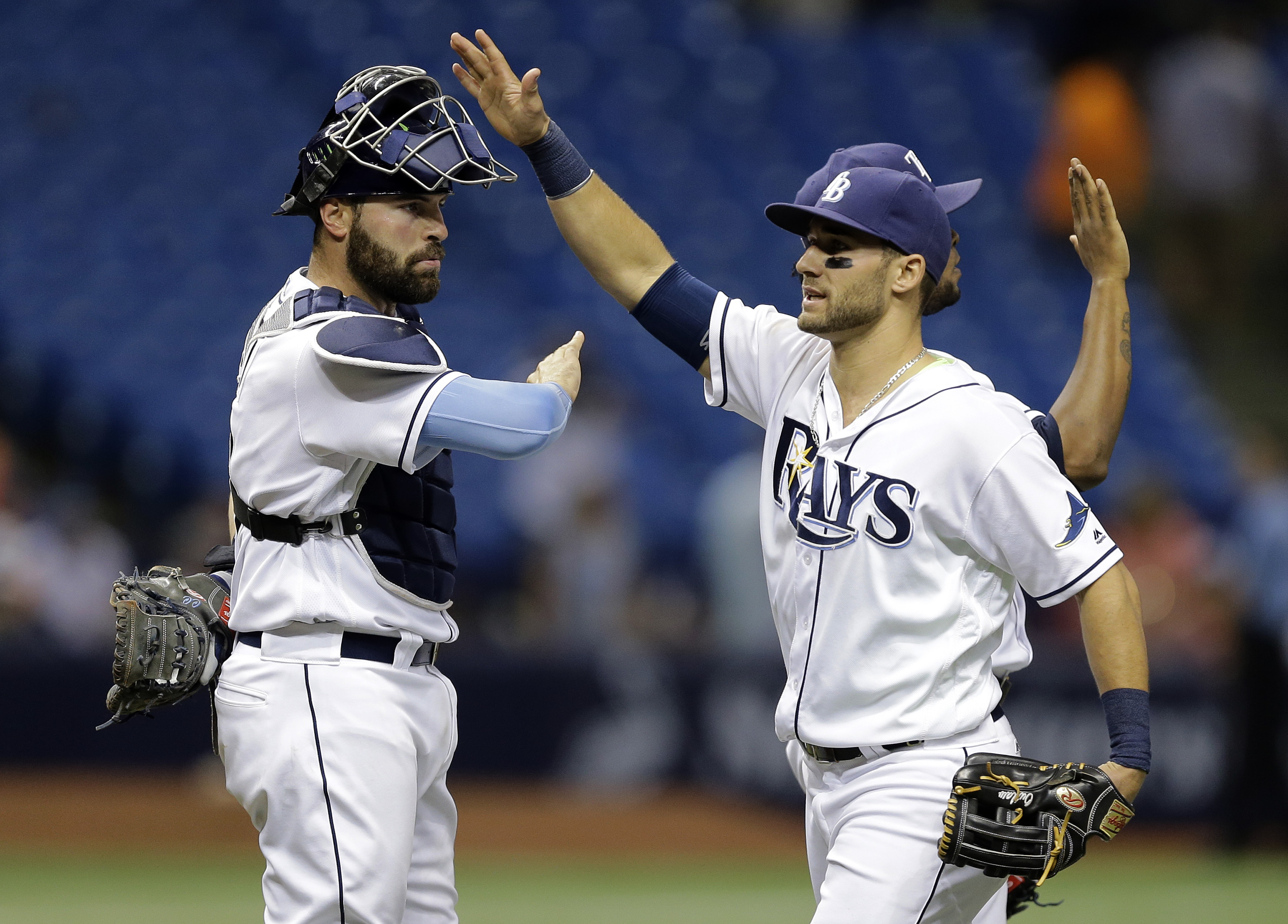 Tampa Bay Rays catcher Curt Casali, left, celebrates with center fielder Kevin Kiermaier after the Rays defeated the Baltimore Orioles 2-0 during a baseball game Monday, April 25, 2016, in St. Petersburg, Fla.  (AP Photo/Chris O'Meara)
