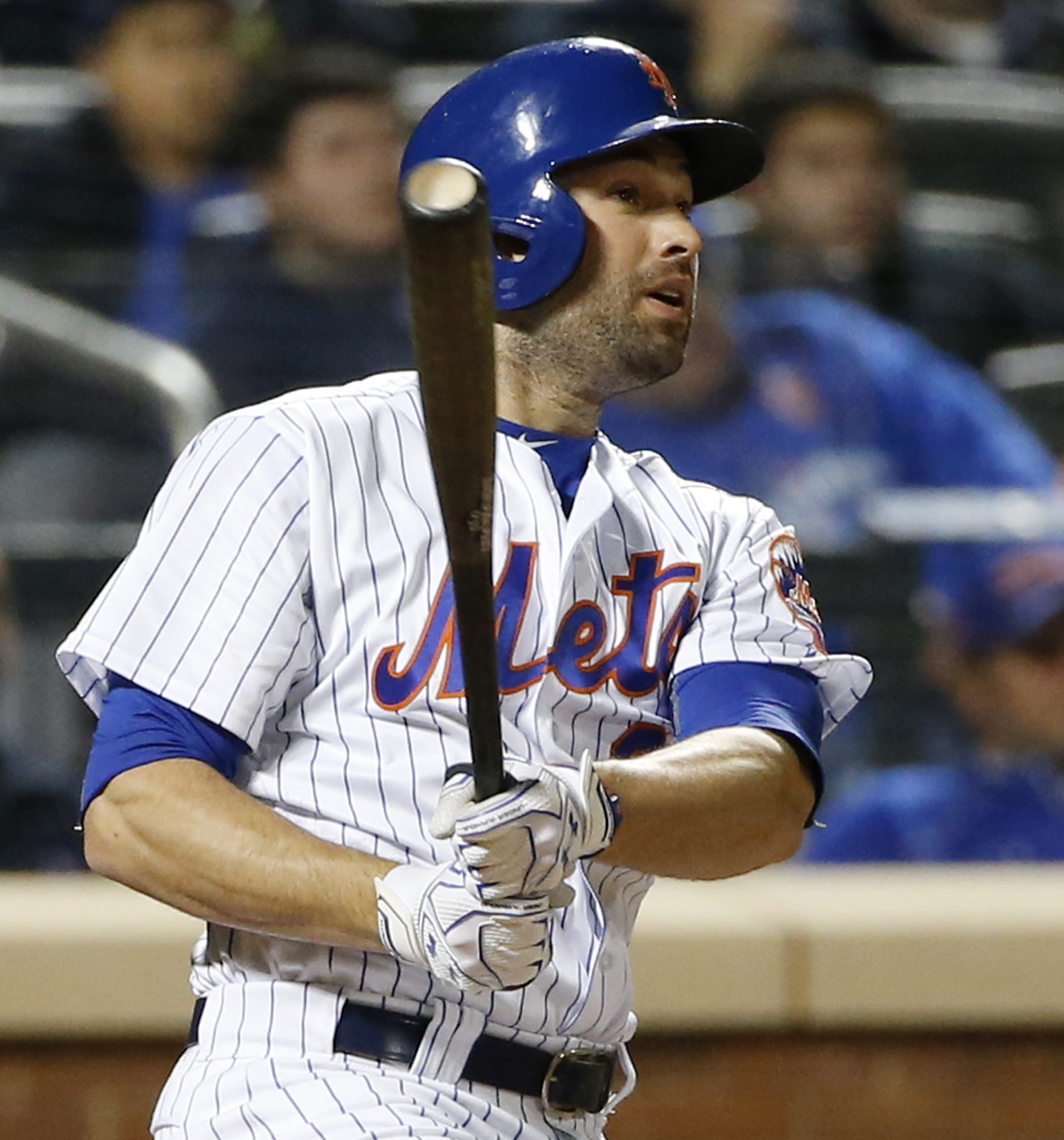 New York Mets Neil Walker (20) watches his seventh-inning, two-run home run in a baseball game against the Cincinnati Reds, Monday, April 25, 2016, in New York. (AP Photo/Kathy Willens)
