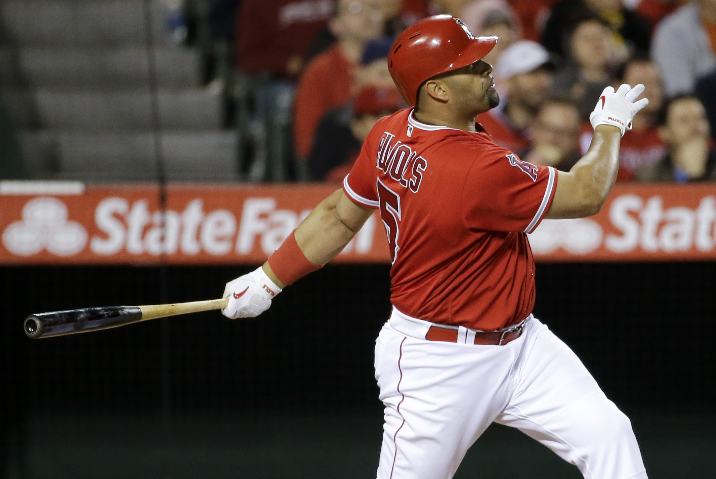 Los Angeles Angels' Albert Pujols watches his home run against the Kansas City Royals during the fifth inning of a baseball game in Anaheim, Calif., Monday, April 25, 2016. (AP Photo/Chris Carlson)