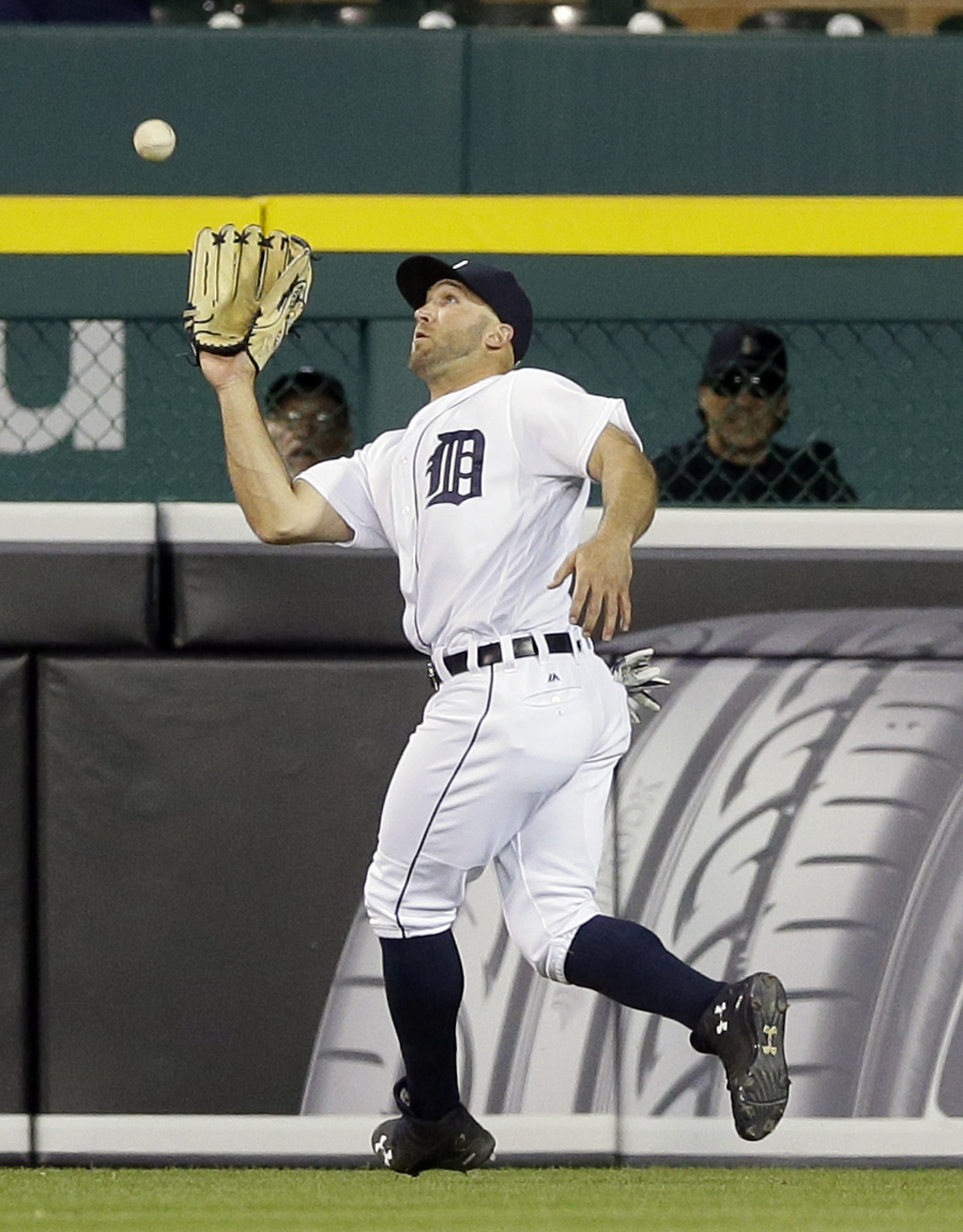 Detroit Tigers center fielder Tyler Collins catches a fly ball hit by Oakland Athletics' Chris Coghlan during the sixth inning of a baseball game, Monday, April 25, 2016 in Detroit. Collins directed an obscene gesture at fans after he lost a ball in the l