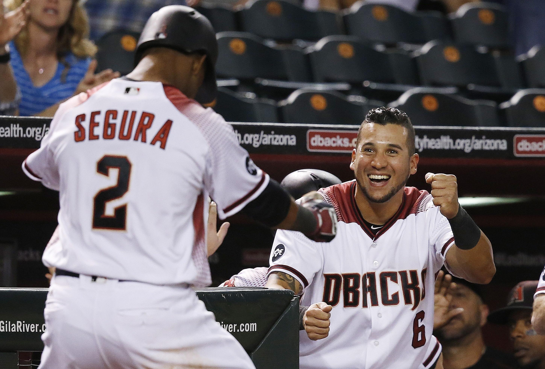 Arizona Diamondbacks' Jean Segura (2) celebrates his three-run home run against the St. Louis Cardinals with David Peralta (6) during the sixth inning of a baseball game Monday, April 25, 2016, in Phoenix. (AP Photo/Ross D. Franklin)