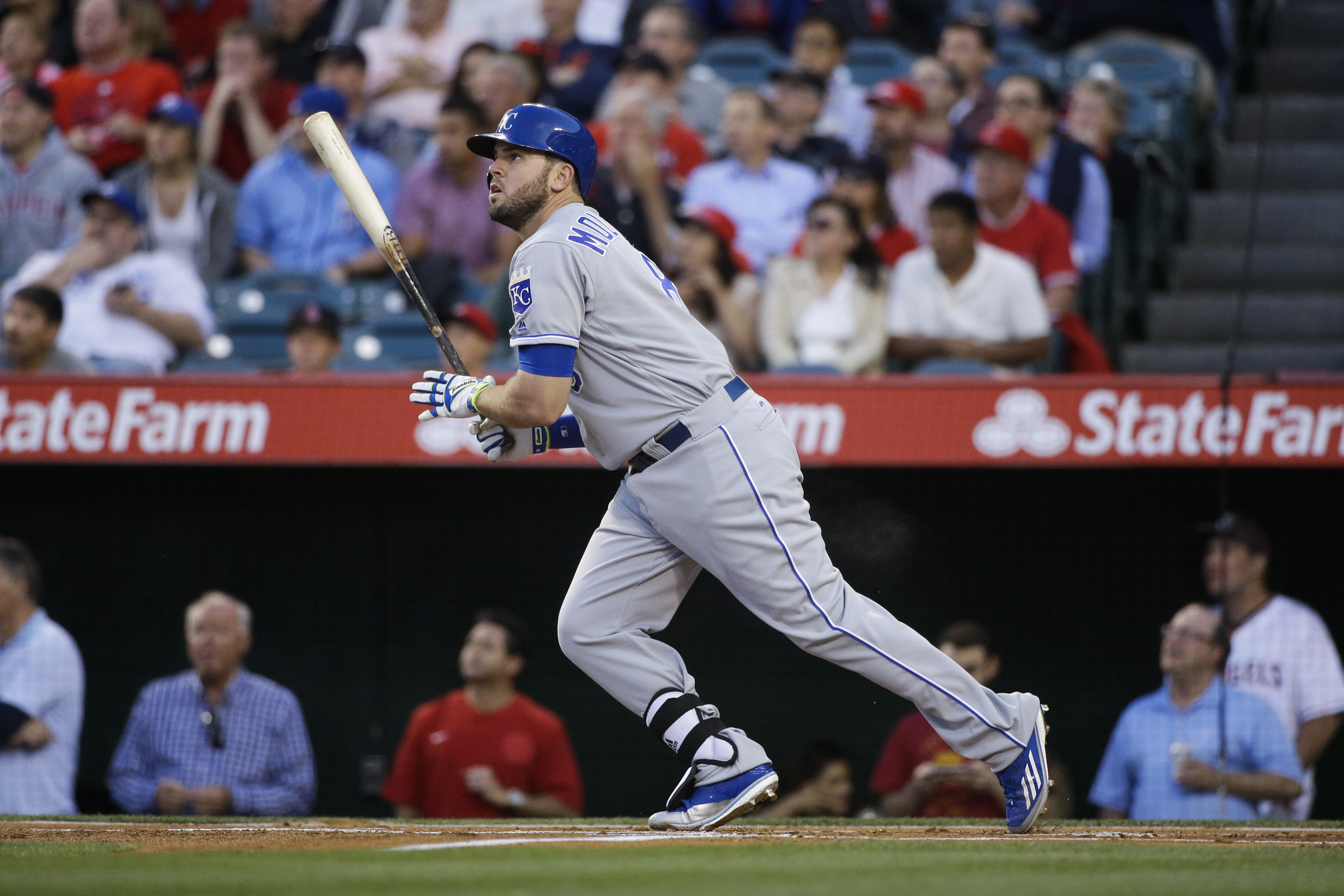Kansas City Royals' Mike Moustakas watches his home run during the first inning of a baseball game against the Los Angeles Angels, Tuesday, April 26, 2016, in Anaheim, Calif. (AP Photo/Jae C. Hong)