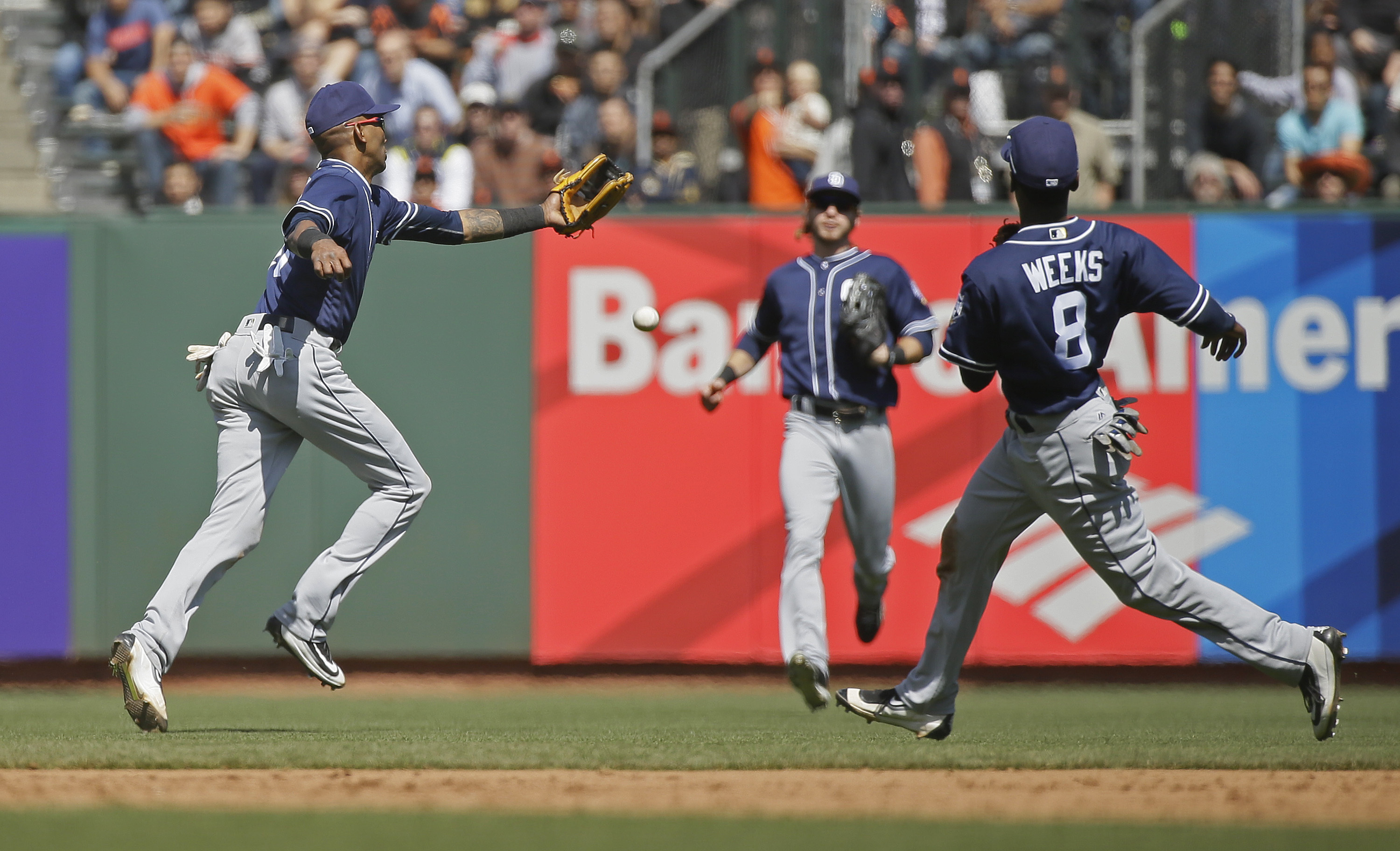 San Diego Padres' Alexei Ramirez misses a soft pop up hit by the San Francisco Giants' Gregor Blanco as second baseman Jemile Weeks (8) and center fielder Travis Jankowski look on in the sixth inning of their baseball game Wednesday, April 27, 2016, in Sa