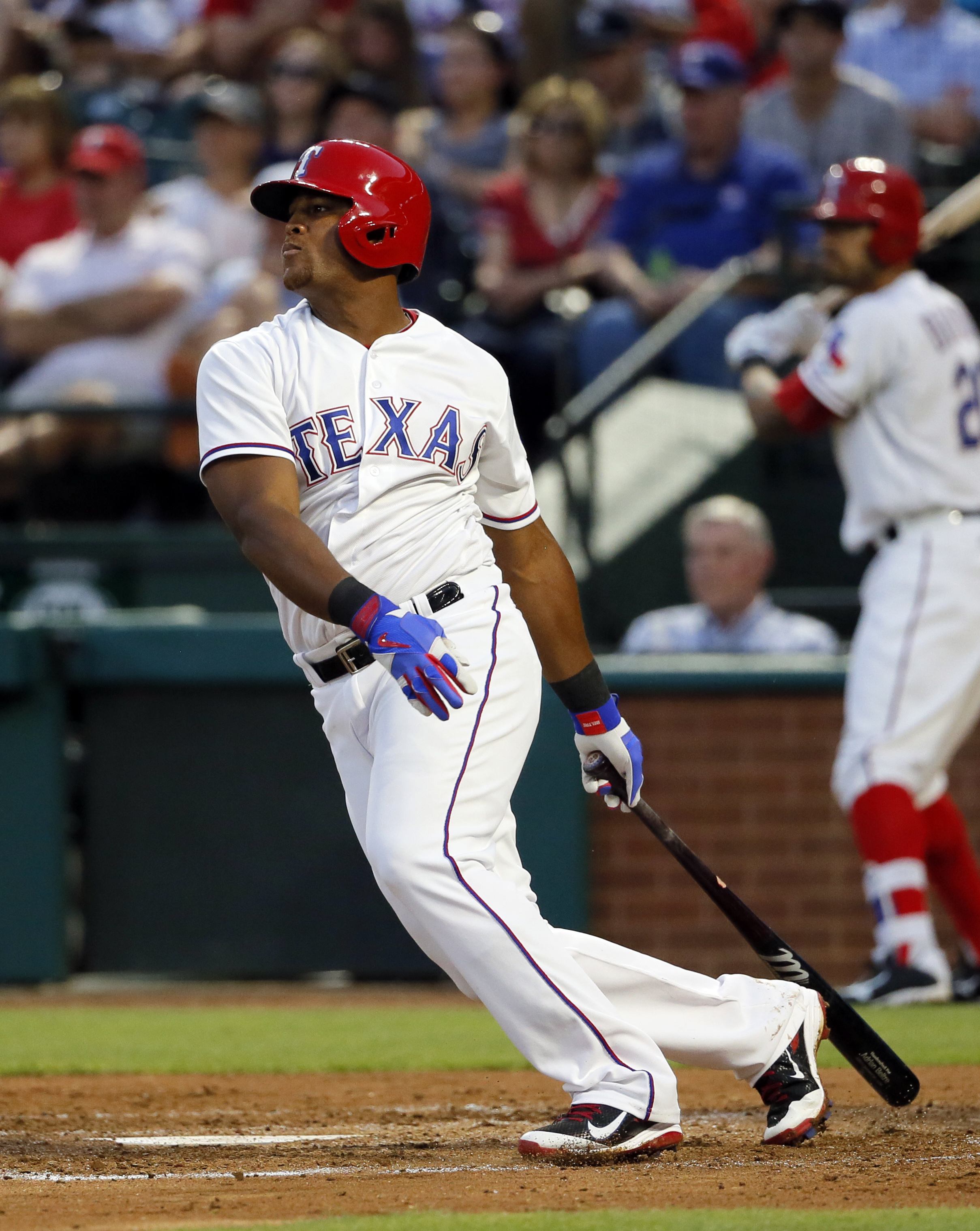 Texas Rangers' Adrian Beltre follows through on a run-scoring single off a pitch from New York Yankees starting pitcher CC Sabathia in the third inning of a baseball game, Wednesday, April 27, 2016, in Arlington, Texas. The hit scored Bryan Holaday. (AP P