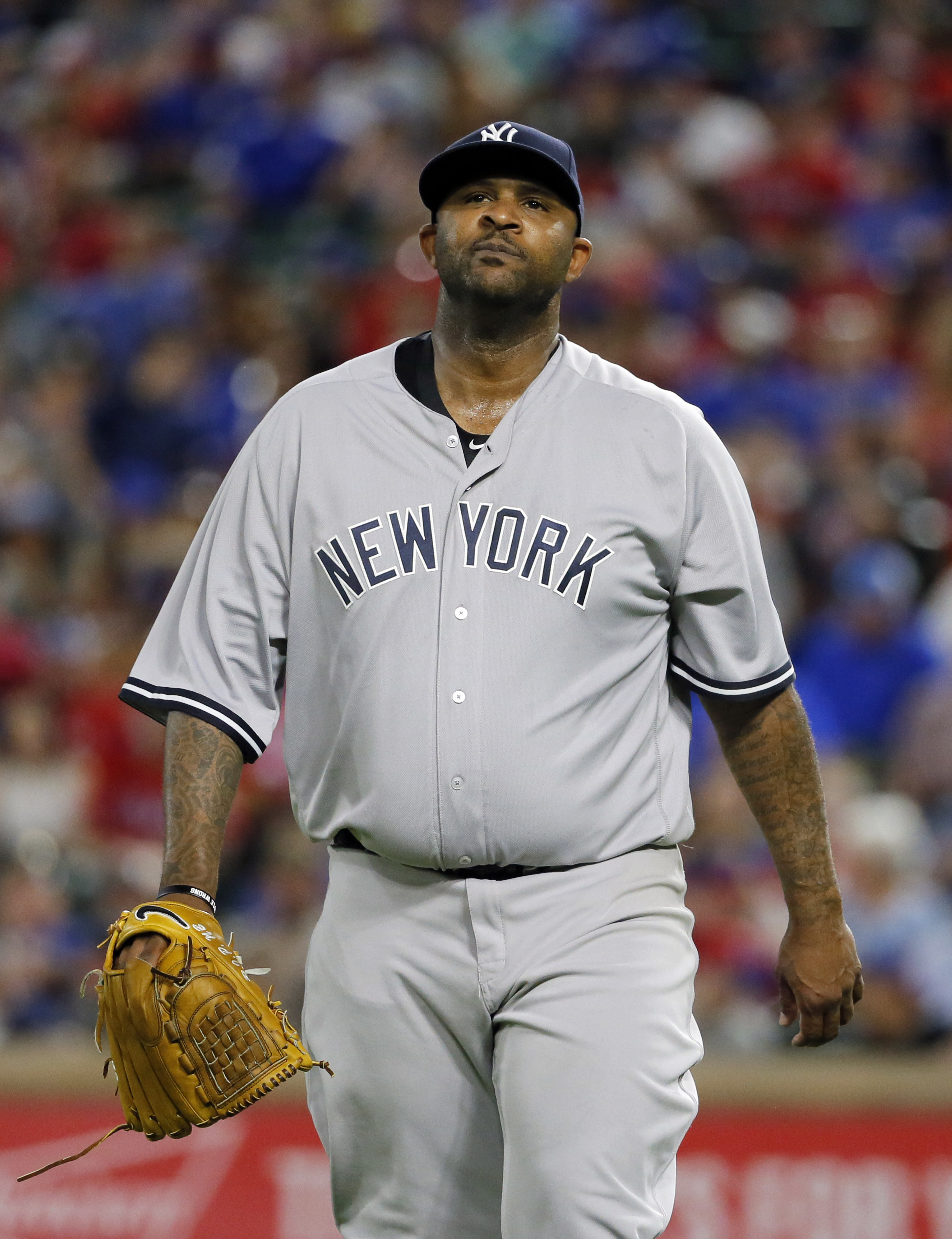 New York Yankees starting pitcher CC Sabathia walks off the mound after the top of the fifth inning of a baseball game against the Texas Rangers on Wednesday, April 27, 2016, in Arlington, Texas. (AP Photo/Tony Gutierrez)